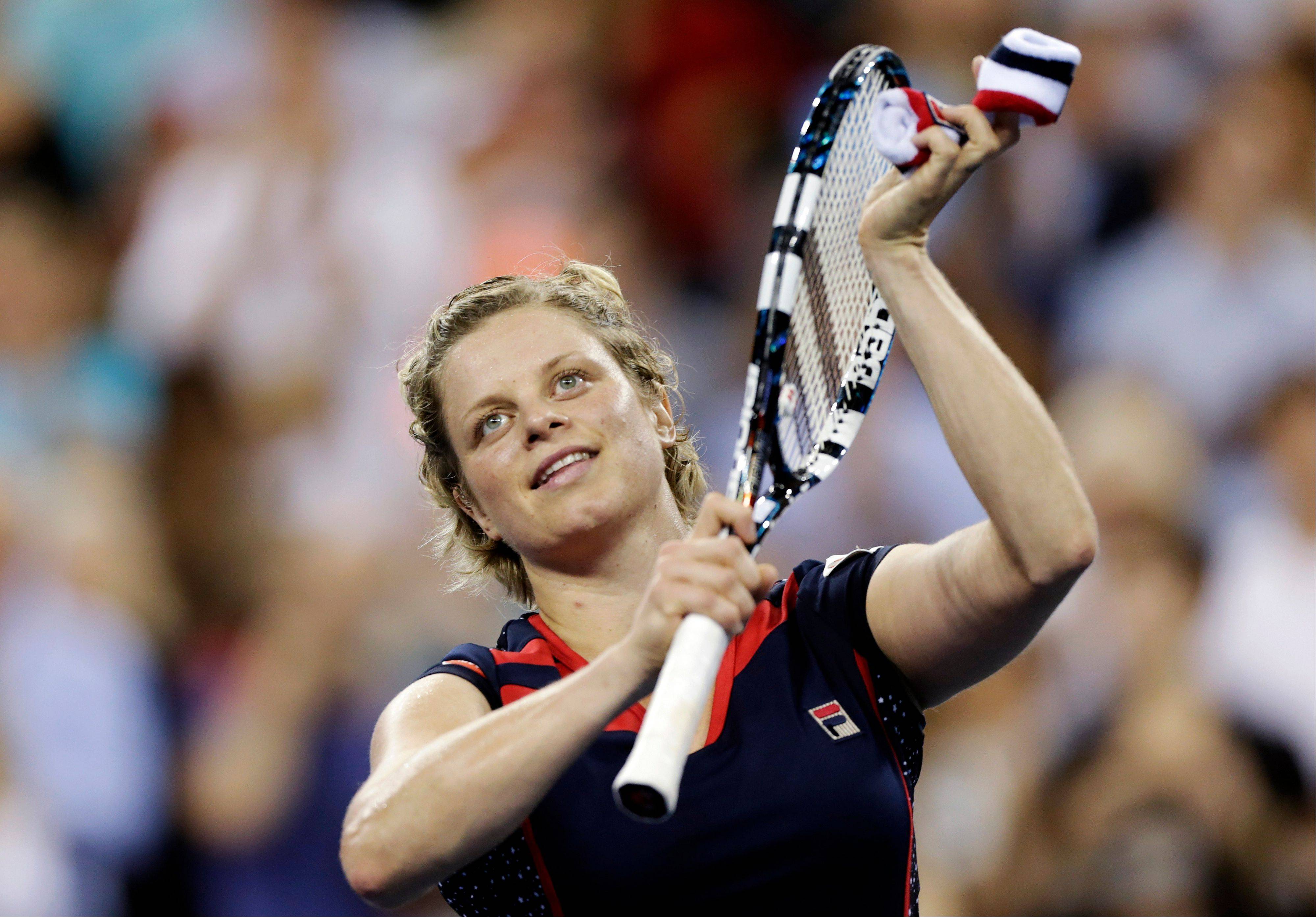 Kim Clijsters thanks the crowd after defeating Victoria Duval 6-3, 6-1 on Monday in the first round of play at the U.S. Open tennis tournament in New York.