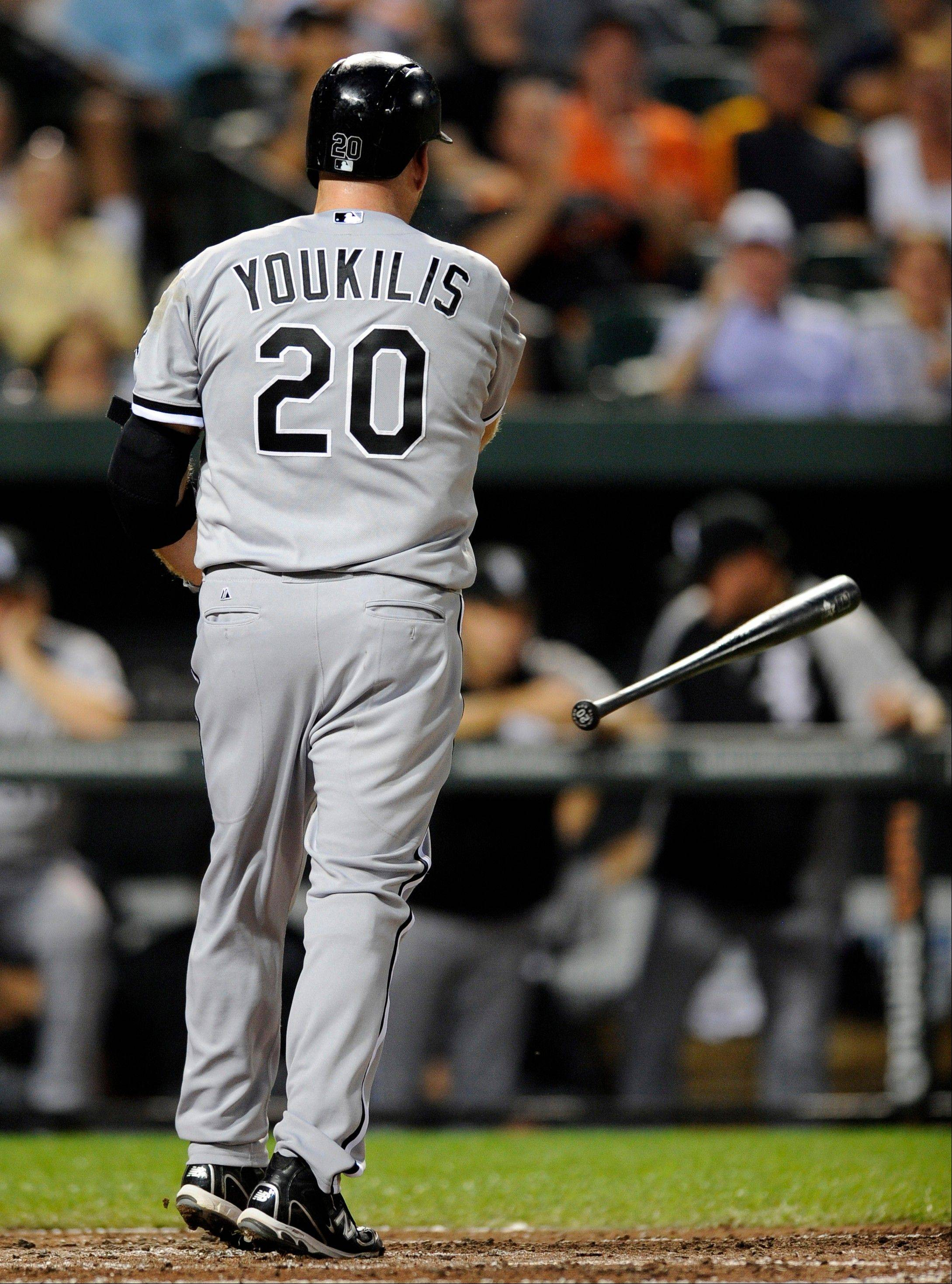 White Sox third baseman Kevin Youkilis throws his bat in frustration after striking out Monday against the Baltimore Orioles.