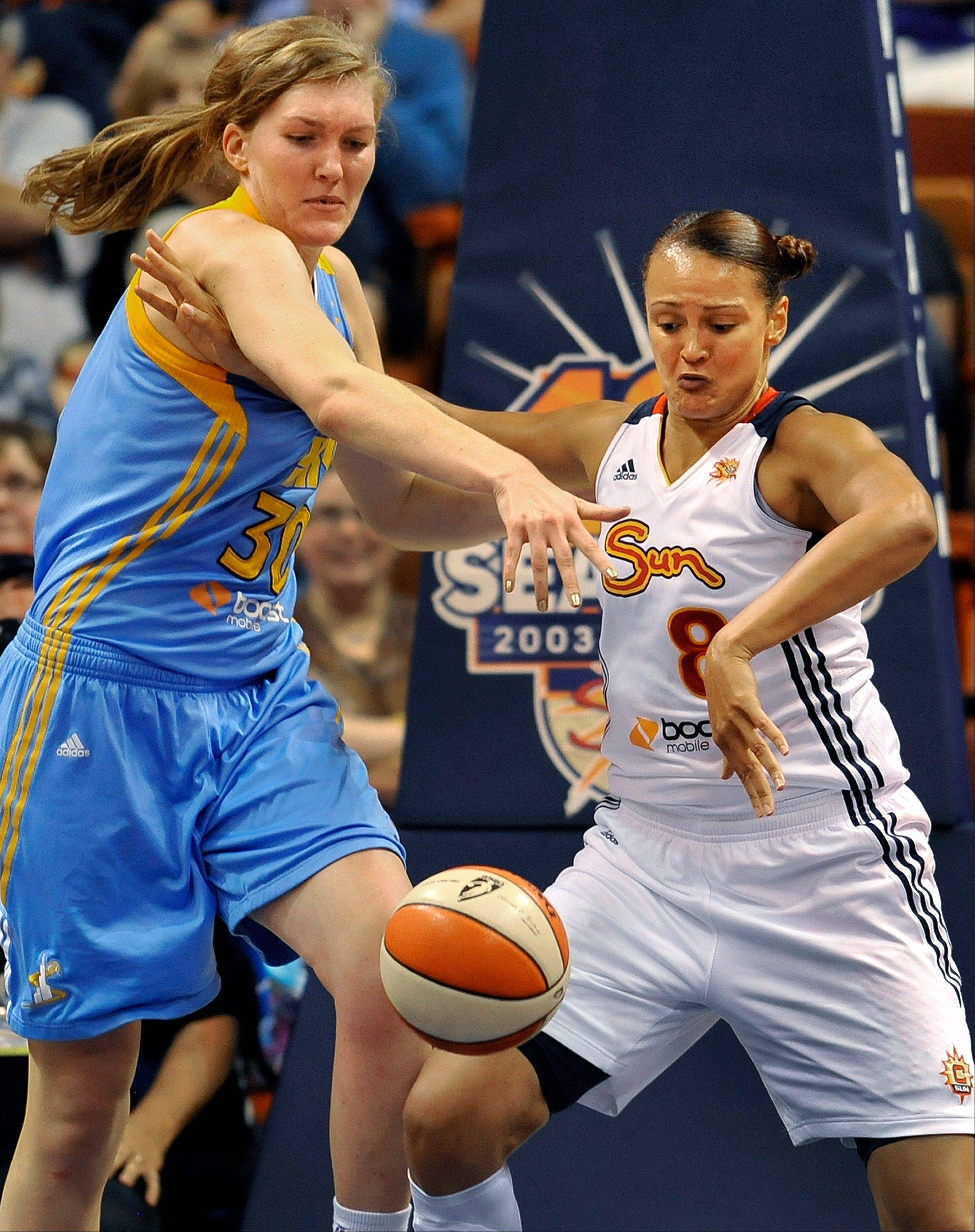 Chicago Sky center Carolyn Swords, left, and Connecticut Sun�s Mistie Mims battle for a rebound Sunday in Uncasville, Conn. Swords filled in for Sylvia Fowles, who missed the game for personal reasons, and contributed 14 points.
