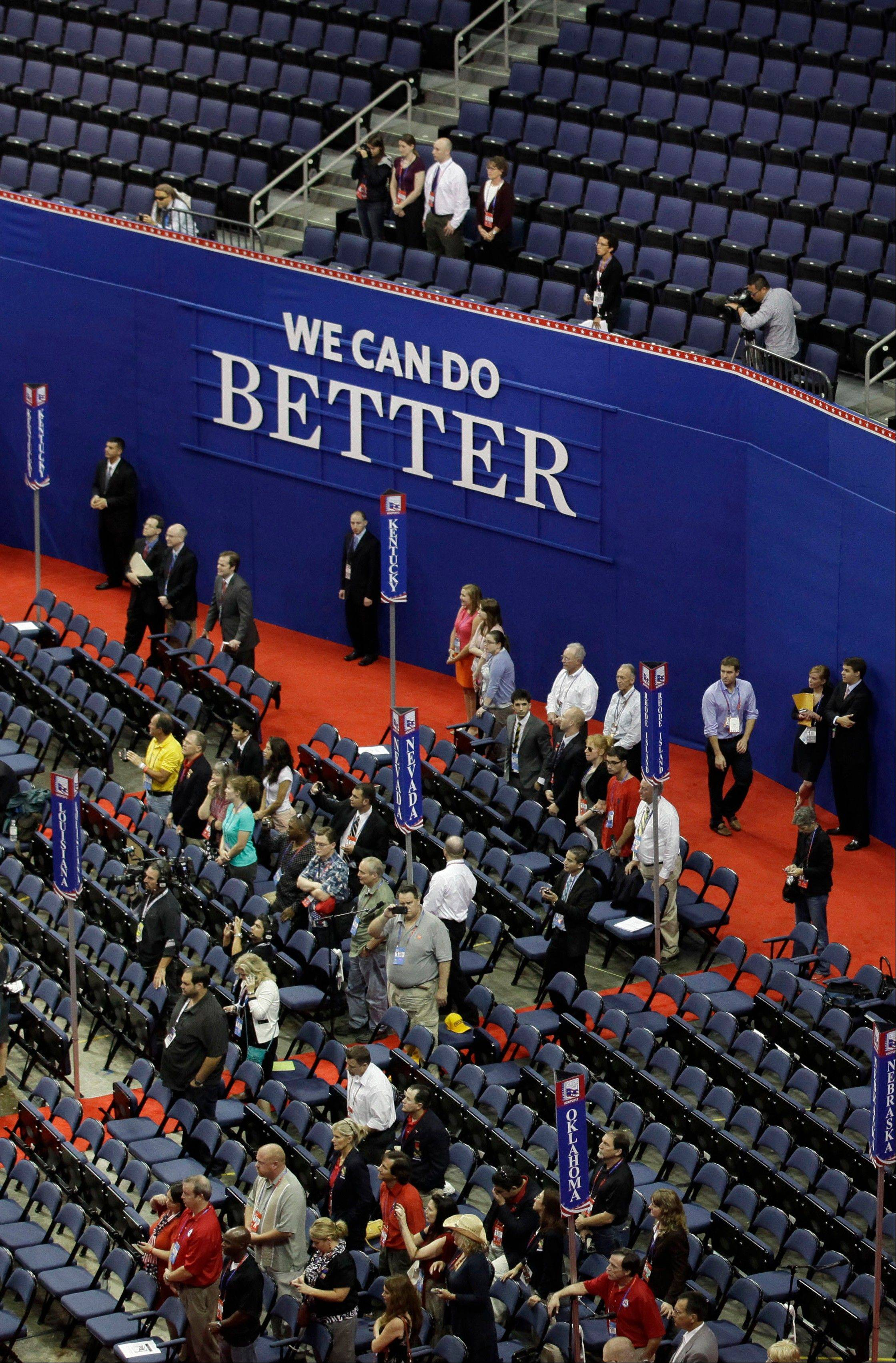 Many empty chairs are seen on the convention floor as Chairman of the Republican National Committee Reince Priebus speaks to delegates during an abbreviated session the party's convention in Tampa, Fla., Monday.