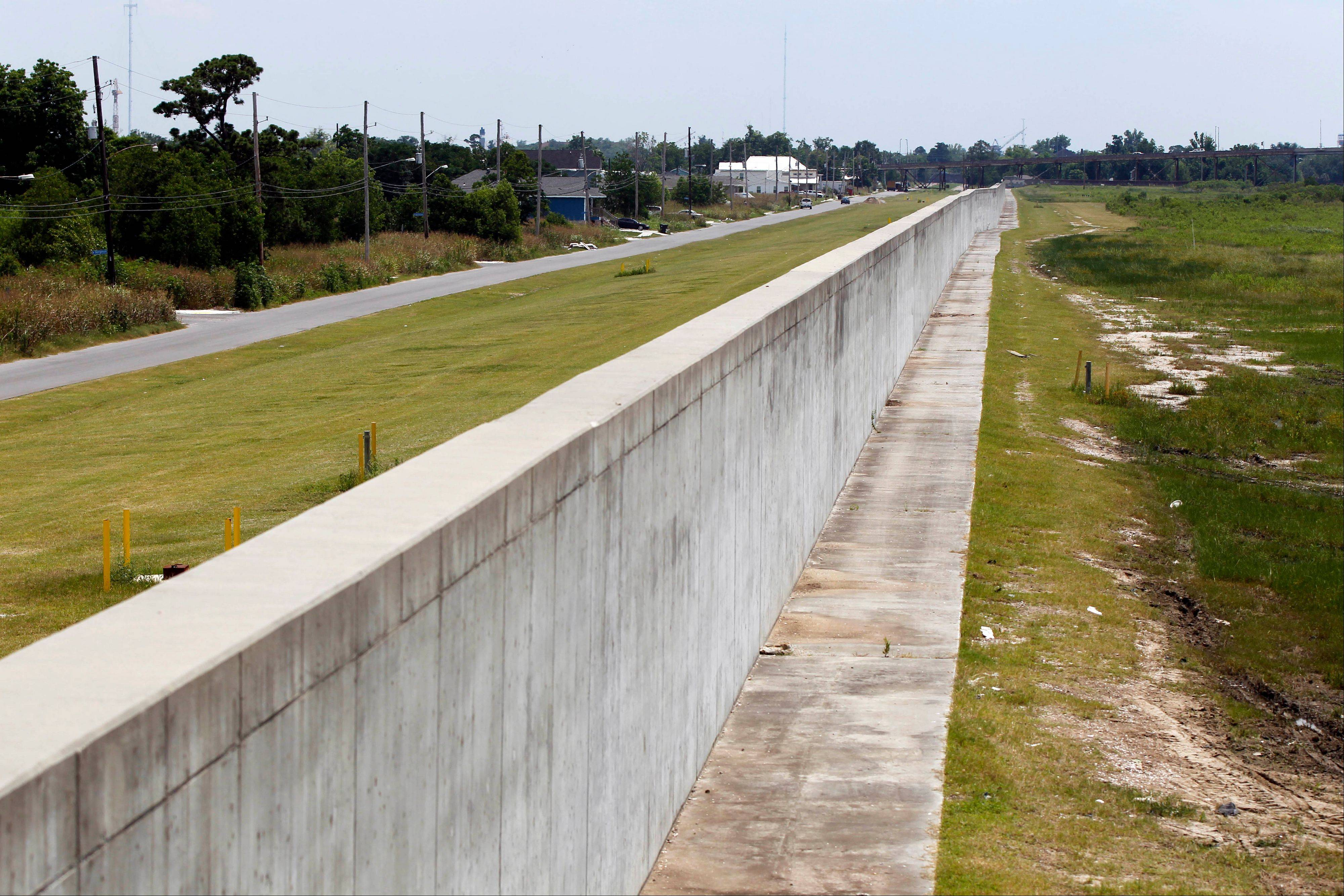 The new levee wall, constructed with reinforced concrete, is seen at one of the breach sites from Hurricane Katrina, in the Lower 9th Ward in New Orleans.