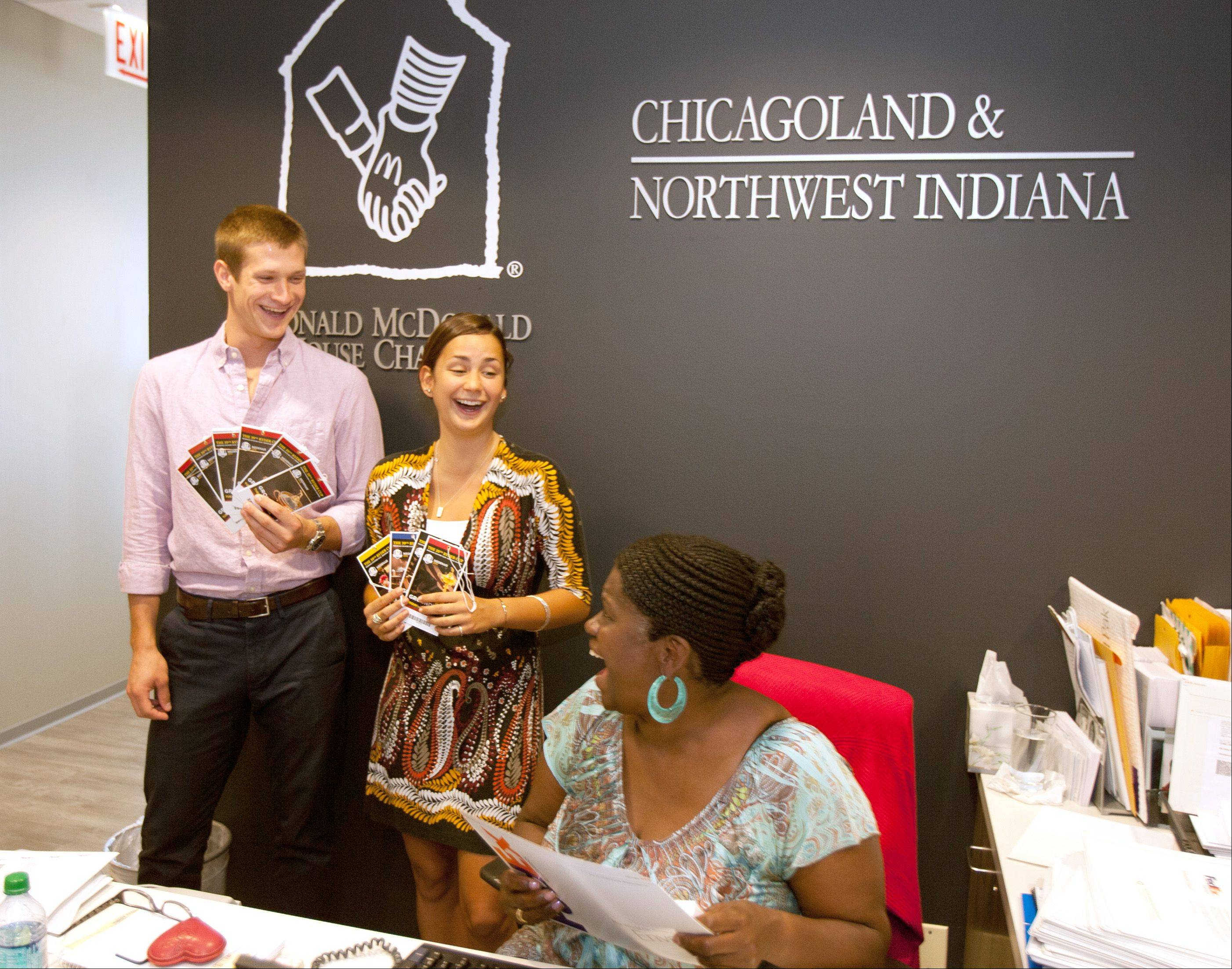 Ronald McDonald charities office Intern Matt Patterson and Development Coordinator Alexa Norberg, center, talk with Office Manager Annette Crouch at the Ronald McDonald charities office in Oak Brook. They are packaging tickets to the sold out Ryder Cup. Just prepare to plunk down a few extra bucks.