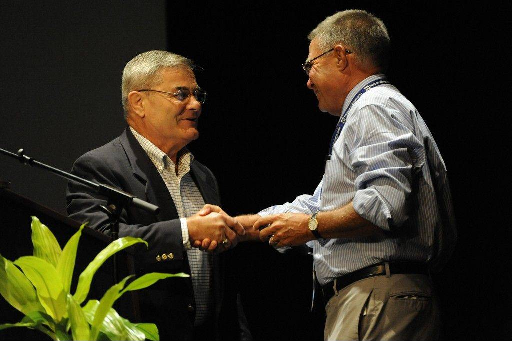 Harper President Ken Ender, right, congratulates Bill Punkay on 45 years with the college.