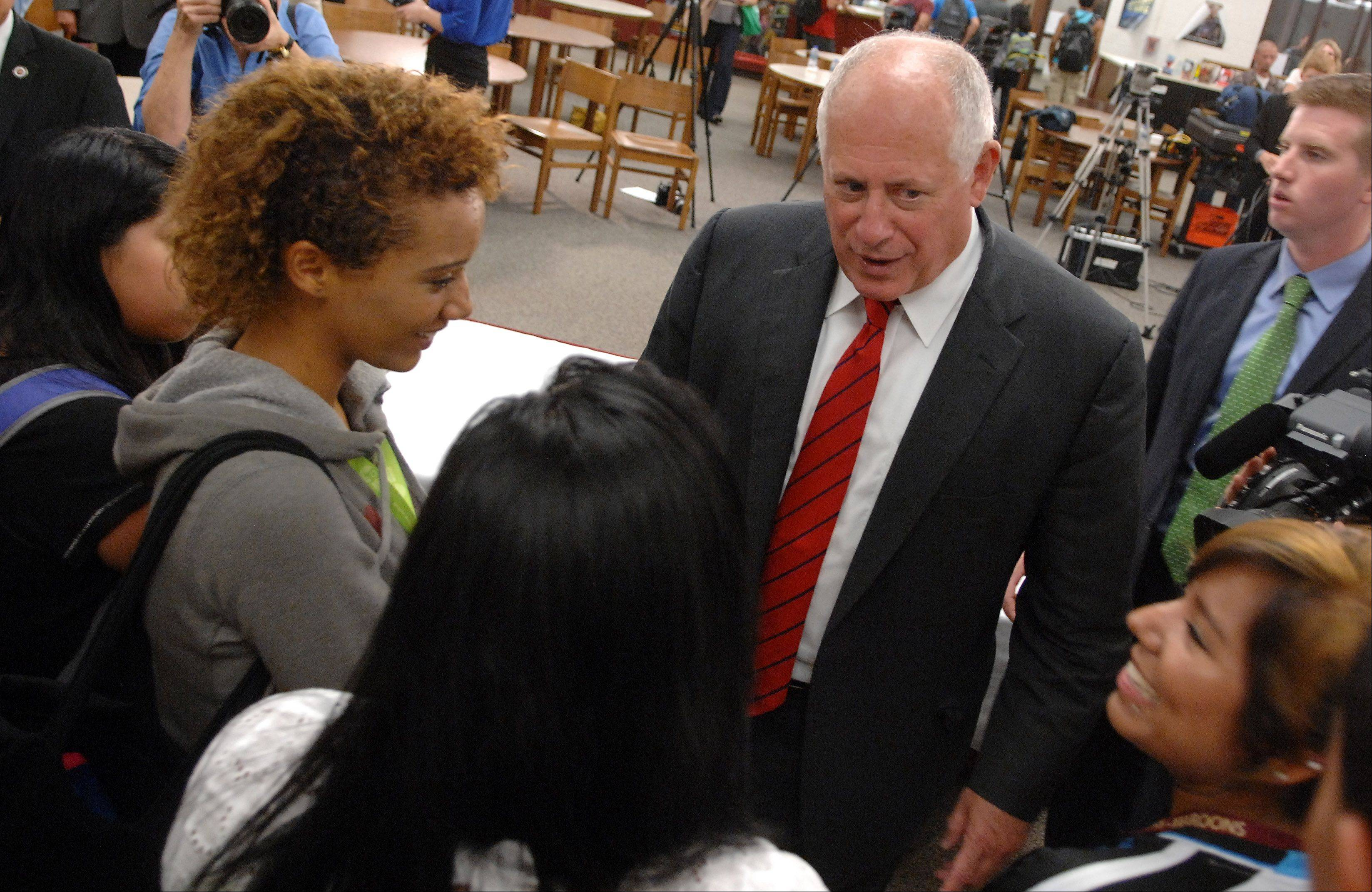Gov. Pat Quinn talks with Elgin High School students Monday after a bill signing.