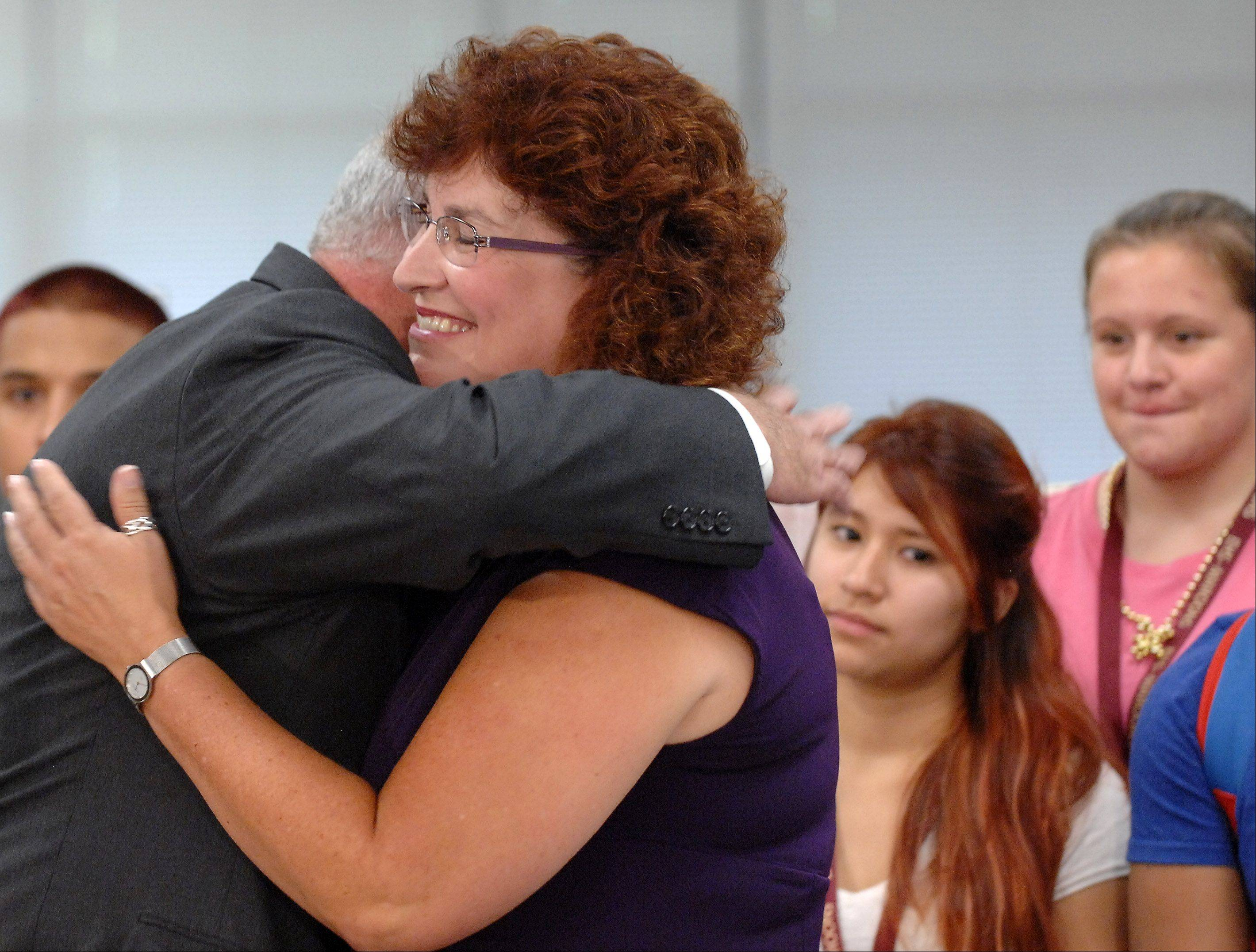 Gov. Pat Quinn hugs Elgin High School teacher Carolyn Gilbert Monday before signing a bill at the school that will allow the police to share information with schools if there is an investigation of a student. The bill is in response to a 2008 attack on Gilbert.