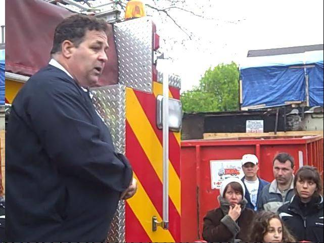 Buffalo Grove Fire Chief Terry Vavra, shown meeting with residents in 2010, and his counterpart in the police department, Chief Steve Balinski, told village trustees this month they're struggling to maintain overtime costs in the face of personnel reductions.