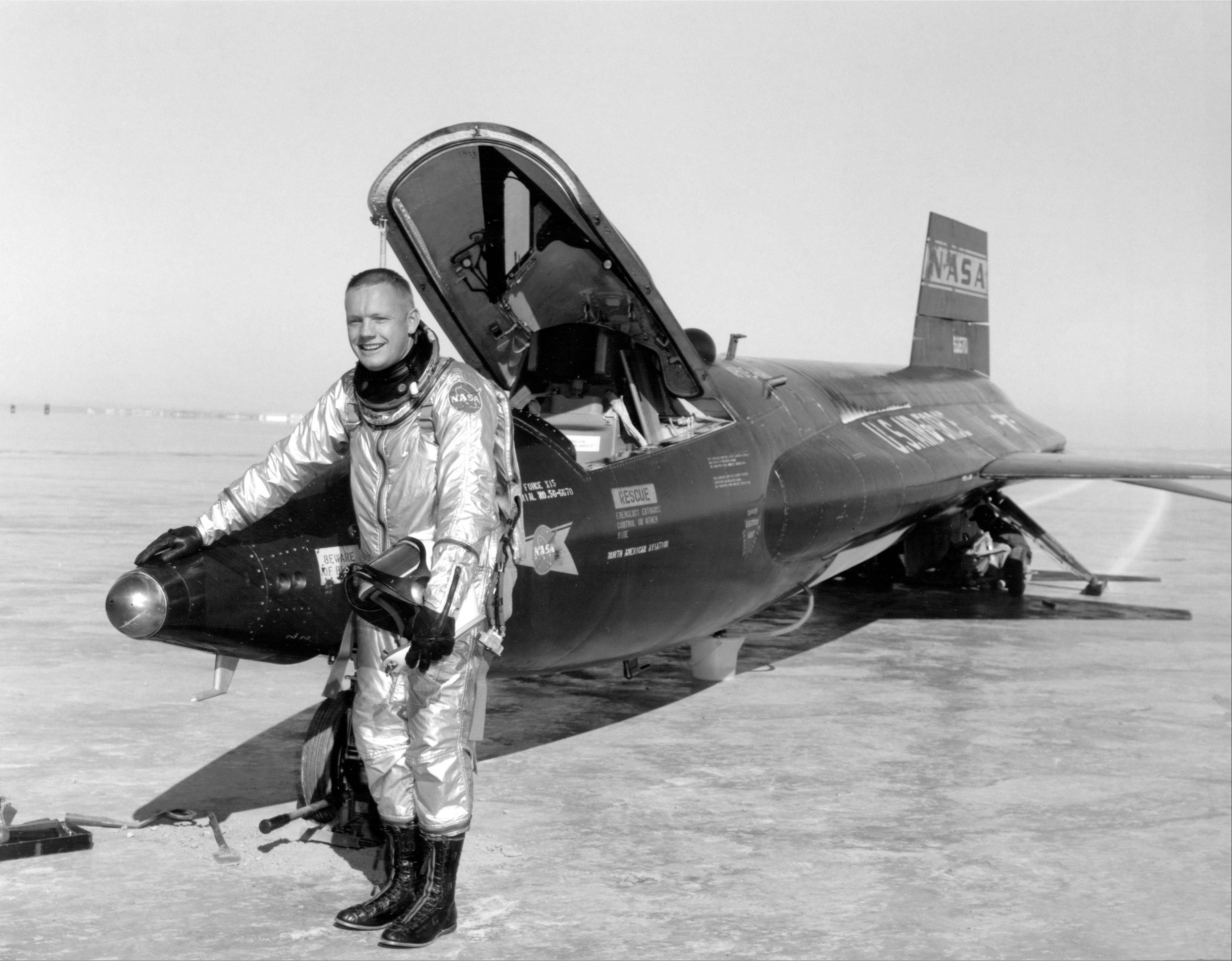 This undated image provided by NASA shows Neil Armstrong posing with a X-15. During re-entry from flight training at 207,000 feet in the X-15, Neil Armstrong inadvertently overshot Edwards Air Force Base in California, heading south at Mach 3 and 100,000 feet altitude. Legend has it he finally managed to turn back while over the Rose Bowl in Pasadena, and had just enough energy to land on the south end of Rogers Dry Lake at Edwards.