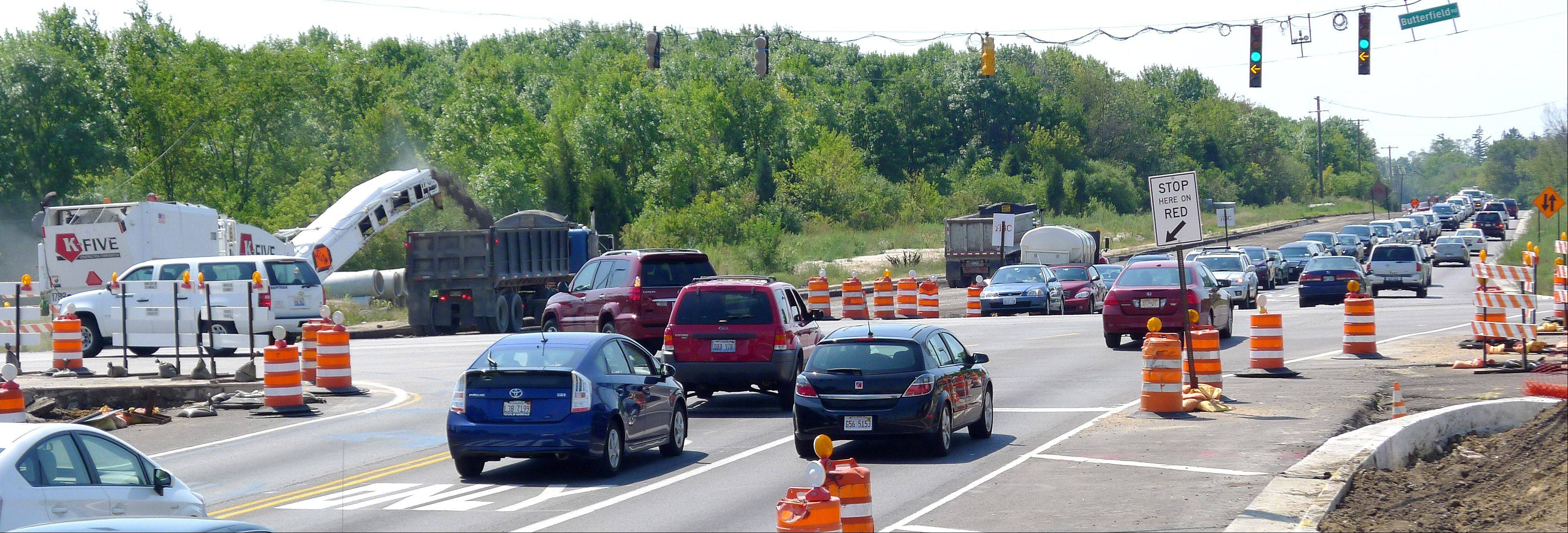 Delays at two major intersections along the $52.5 million Butterfield Road widening project are expected to last until late fall.