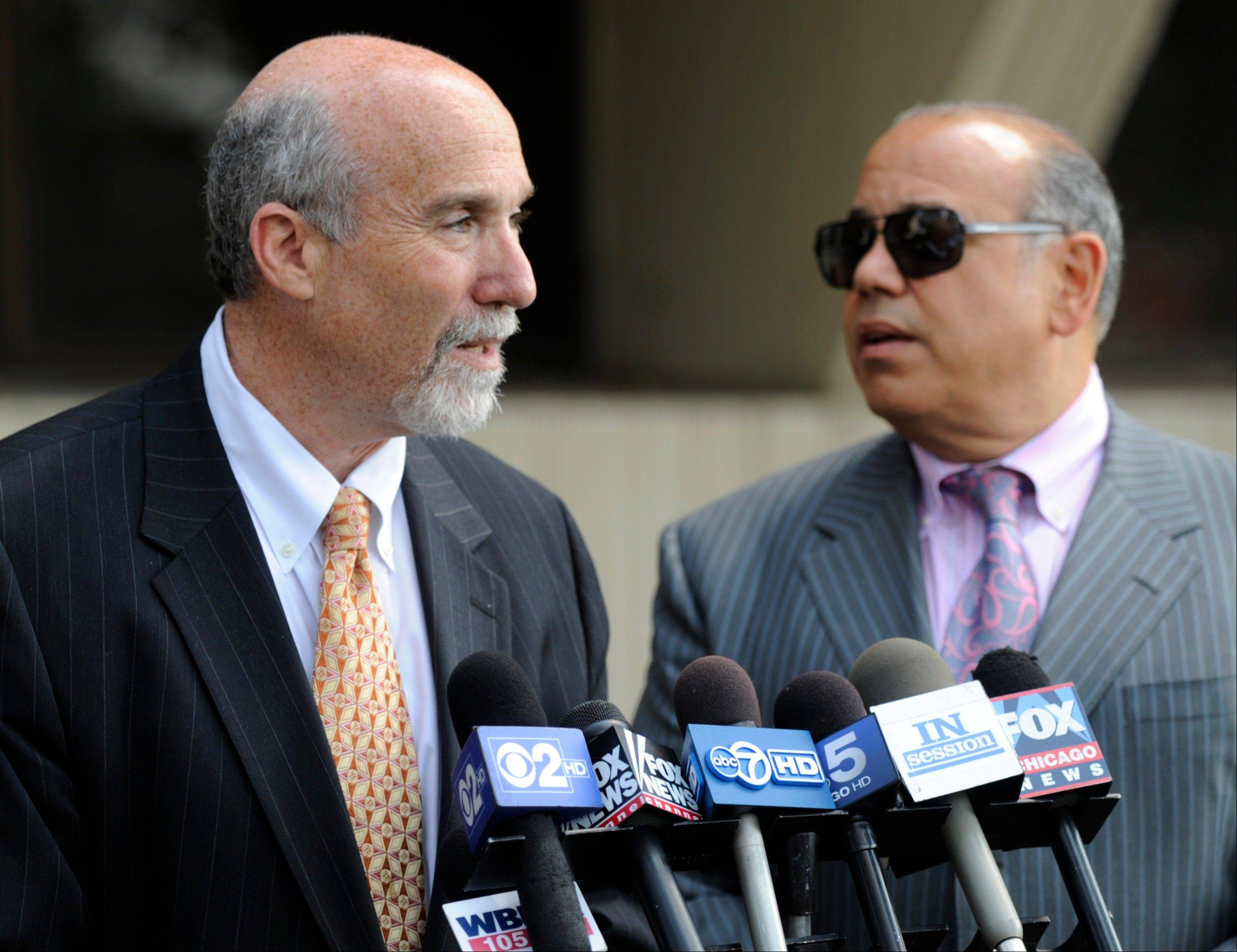 Joel Brodsky, left, and Joe Lopez, defense attorneys for former Bolingbrook police sergeant Drew Peterson, speak to the media outside the Will County courthouse in Joliet during a break in Peterson's murder trial on Monday.