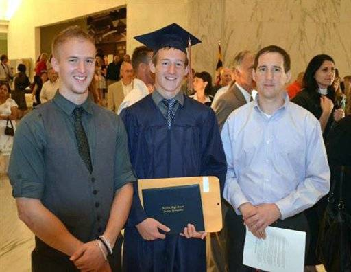 In this June 9, 2012, photo provided by Justin Strine, Strine, left, poses with his younger brother Jamie Strine, center, and older brother, Jim Strine, at Jamie's high school graduation in Hershey, PA. Justin Strine's hopes for a military career as an Army officer ended after he was kicked out from ROTC for participating in a riot at Penn Statee after Hall of Fame coach Joe Paterno's firing in November 2011.
