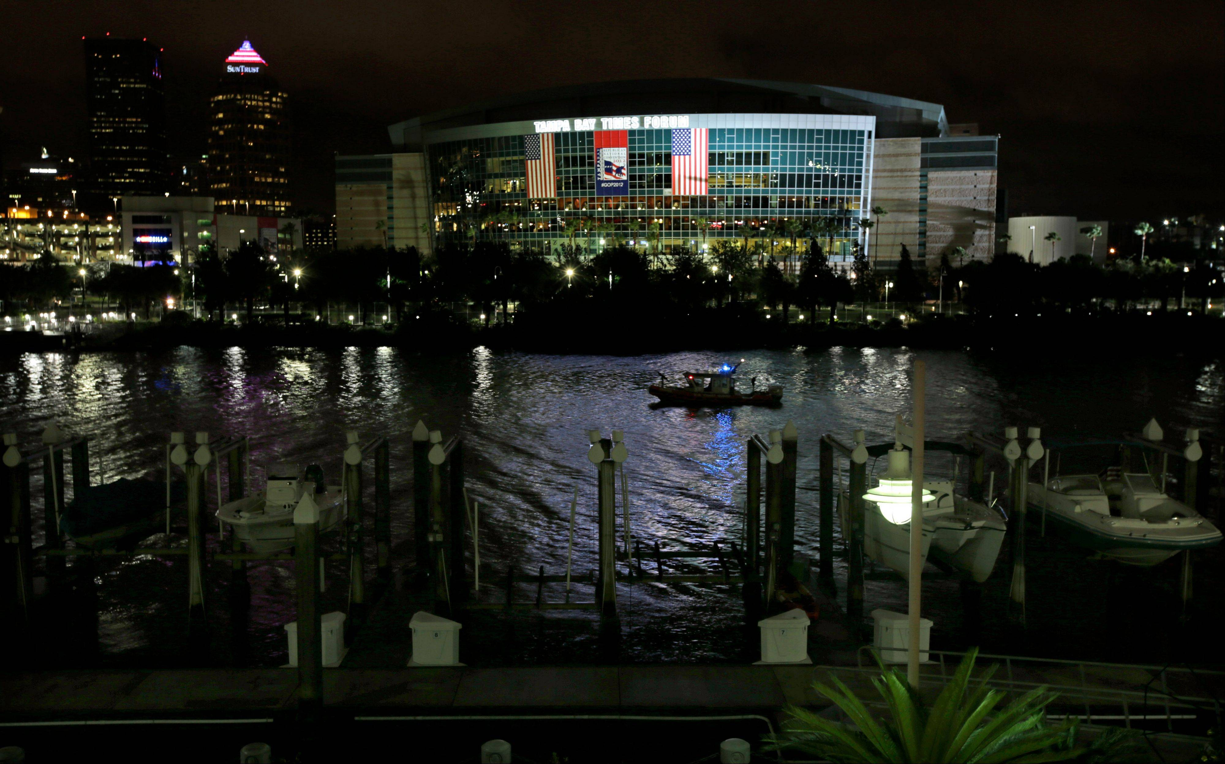 A Coast Guard patrol boat cruises past the Tampa Bay Times Forum in Tampa, Fla., Monday, Aug. 27, 2012. The start of the Republican National Convention, being held at the facility, has been delayed because of the approaching tropical storm Isaac.