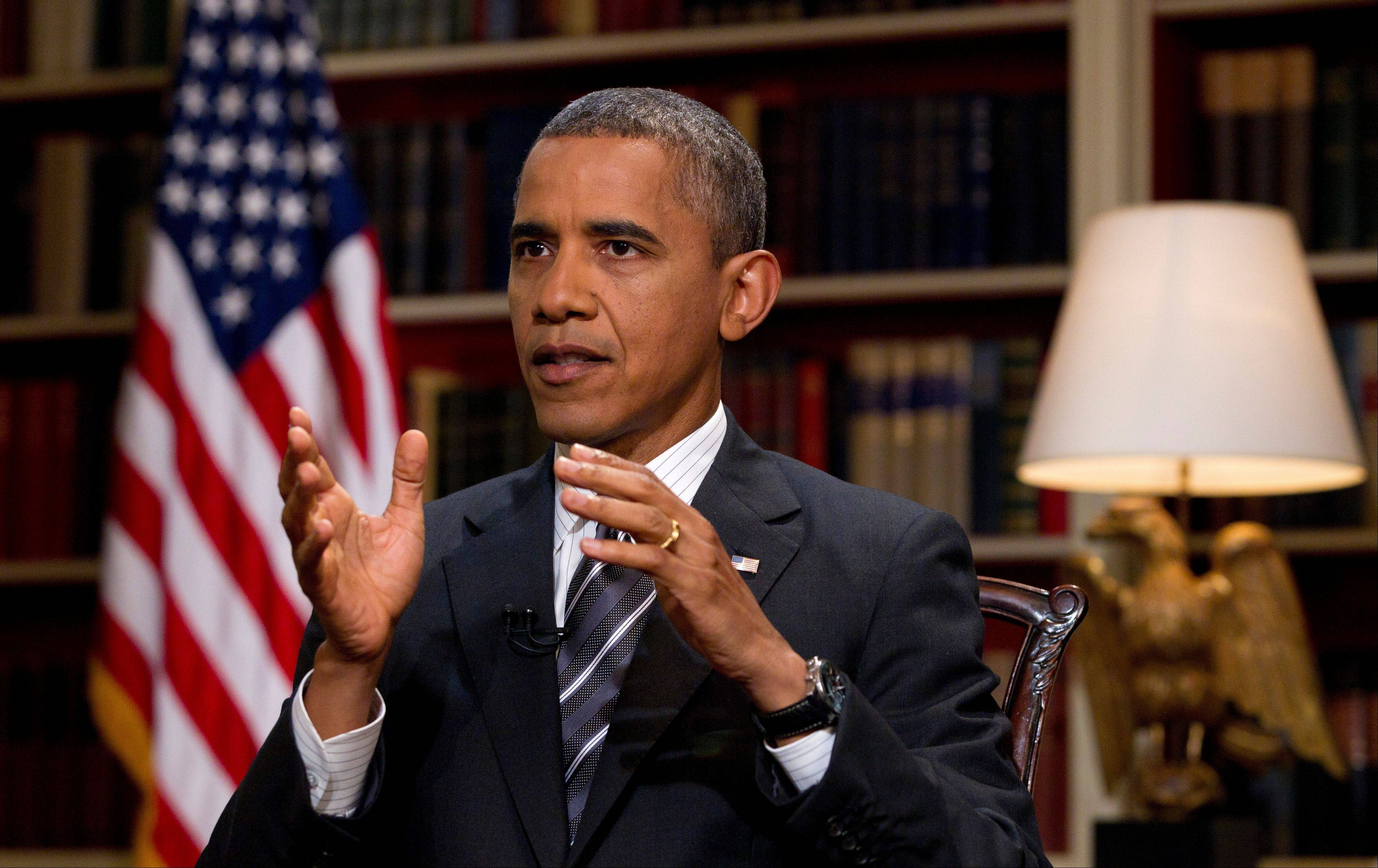 President Barack Obama speaks during an interview with The Associated Press at the White House, Thursday, Aug. 23, 2012, in Washington. Obama talked about the presidential race and Republican challenger Mitt Romney in the exclusive AP interview before heading off to a long weekend with his family at Camp David, the secluded presidential retreat in the Maryland mountains. His comments come ahead of the GOP convention opening Aug. 27, 2012, in Tampa, Fla.