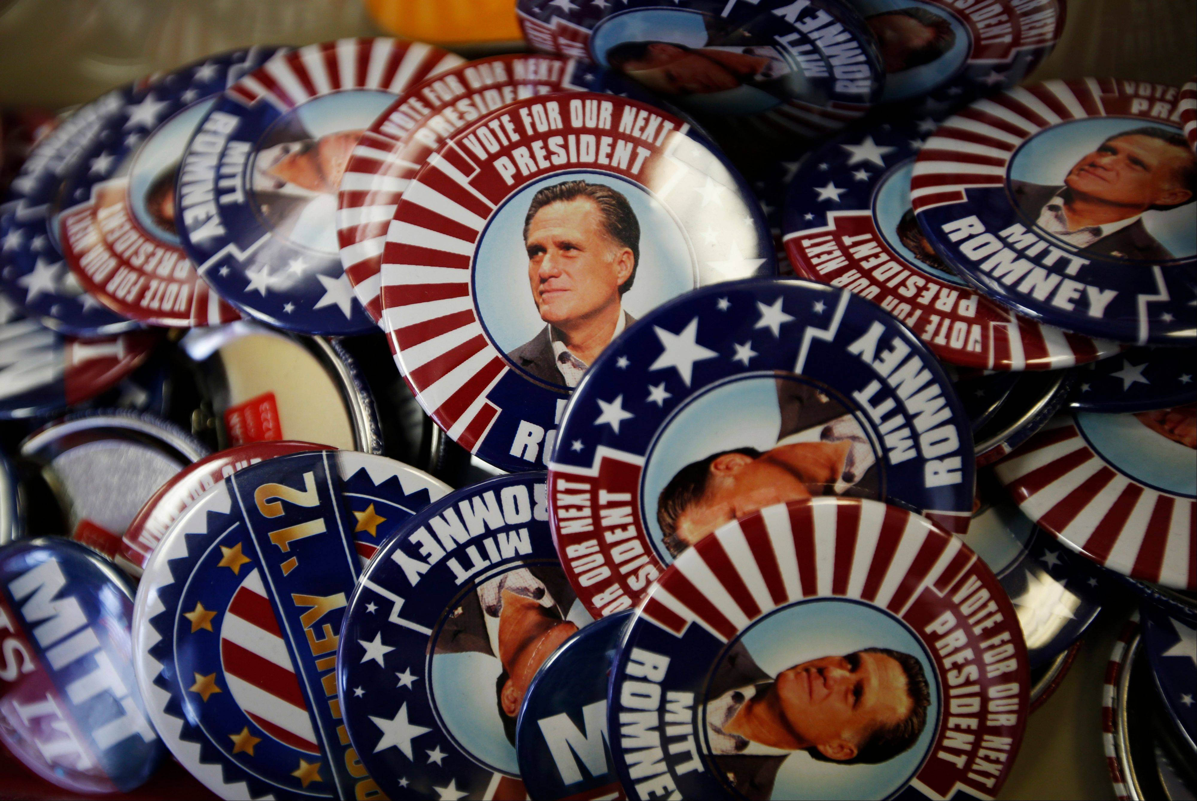 Republican presidential candidate and former Massachusetts Gov. Mitt Romney campaign buttons are displayed ahead of the Republican National Convention in Tampa, Fla., Sunday.