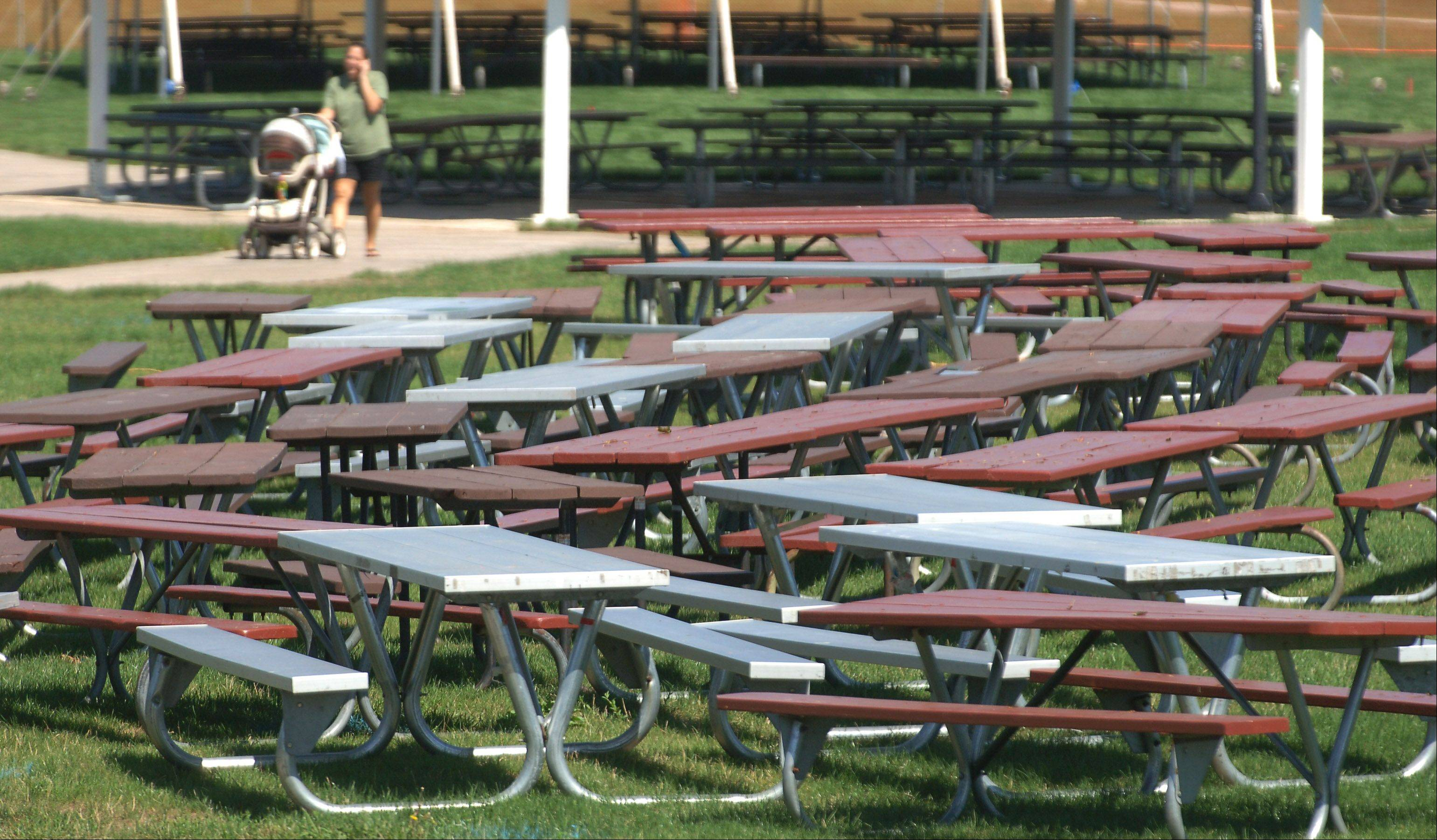 Picnic tables are ready to be placed and crews began setting up tents Tuesday in preparation for the Little Bear Ribfest at Century Park in Vernon Hills. The fest takes place Friday evening and Saturday with food and live musical performances.