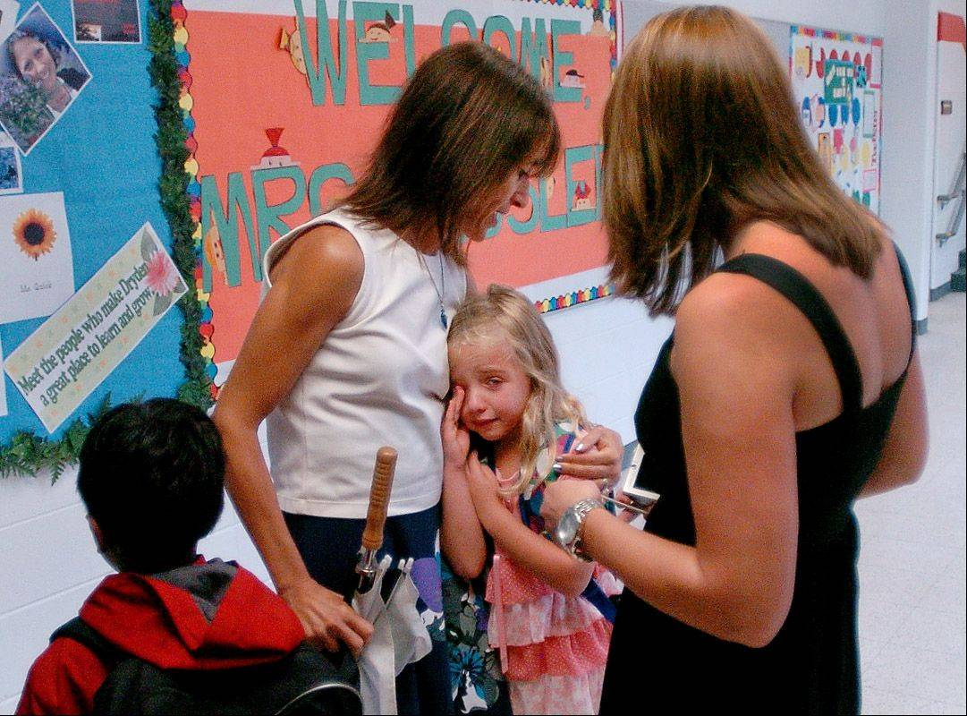 Maria Shane consoles her daughter Nicole while waiting in line for first grade on her first day of school at Dryden Elementary School.