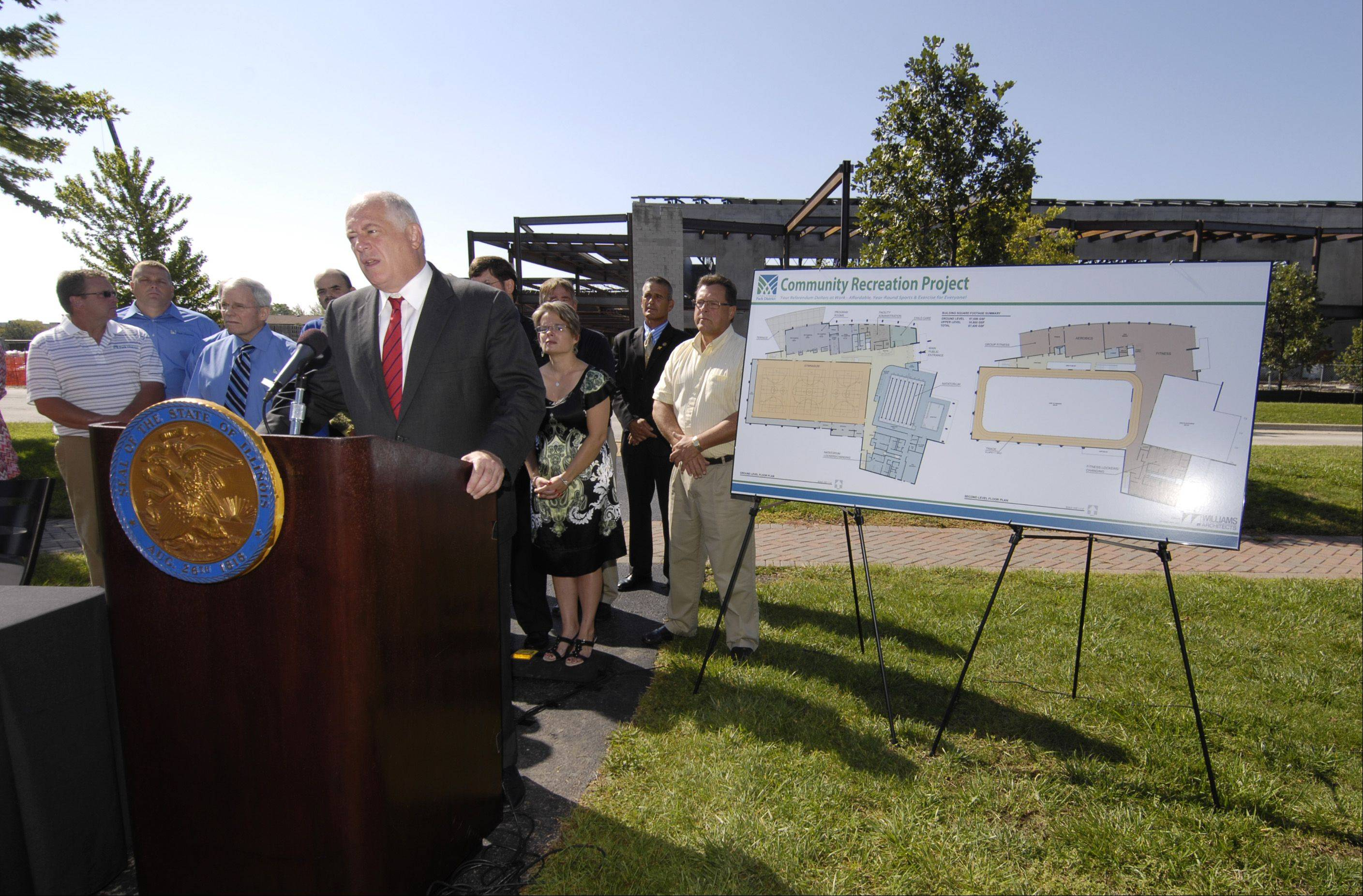 With the construction site of the new Carol Stream recreation center as a backdrop, Gov. Pat Quinn signs a bill Monday allowing the Carol Stream Park District to fully realize all $37 million in referendum dollars approved by voters in 2010.