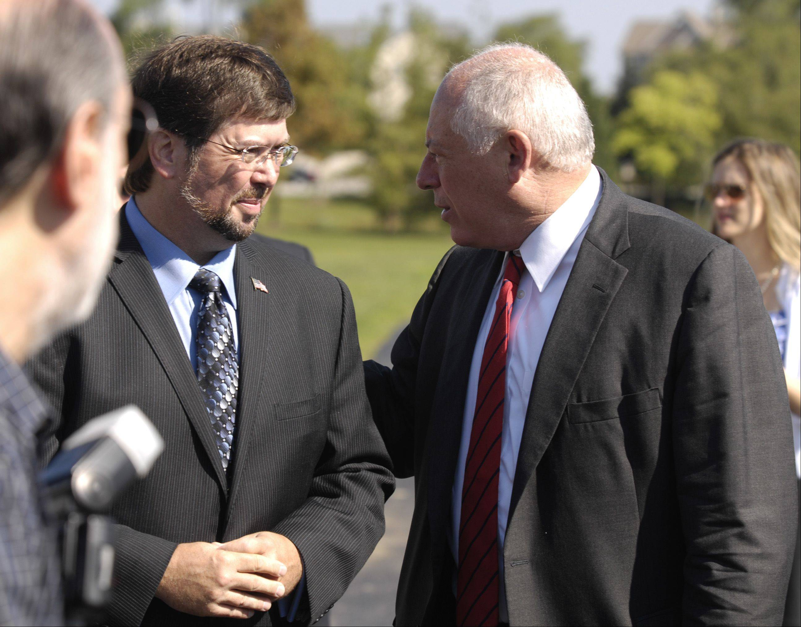 State Rep. Randy Ramey, left, talks with Gov. Pat Quinn Monday before a bill signing allowing the Carol Stream Park District to fully realize all $37 million in referendum dollars approved by voters in 2010.
