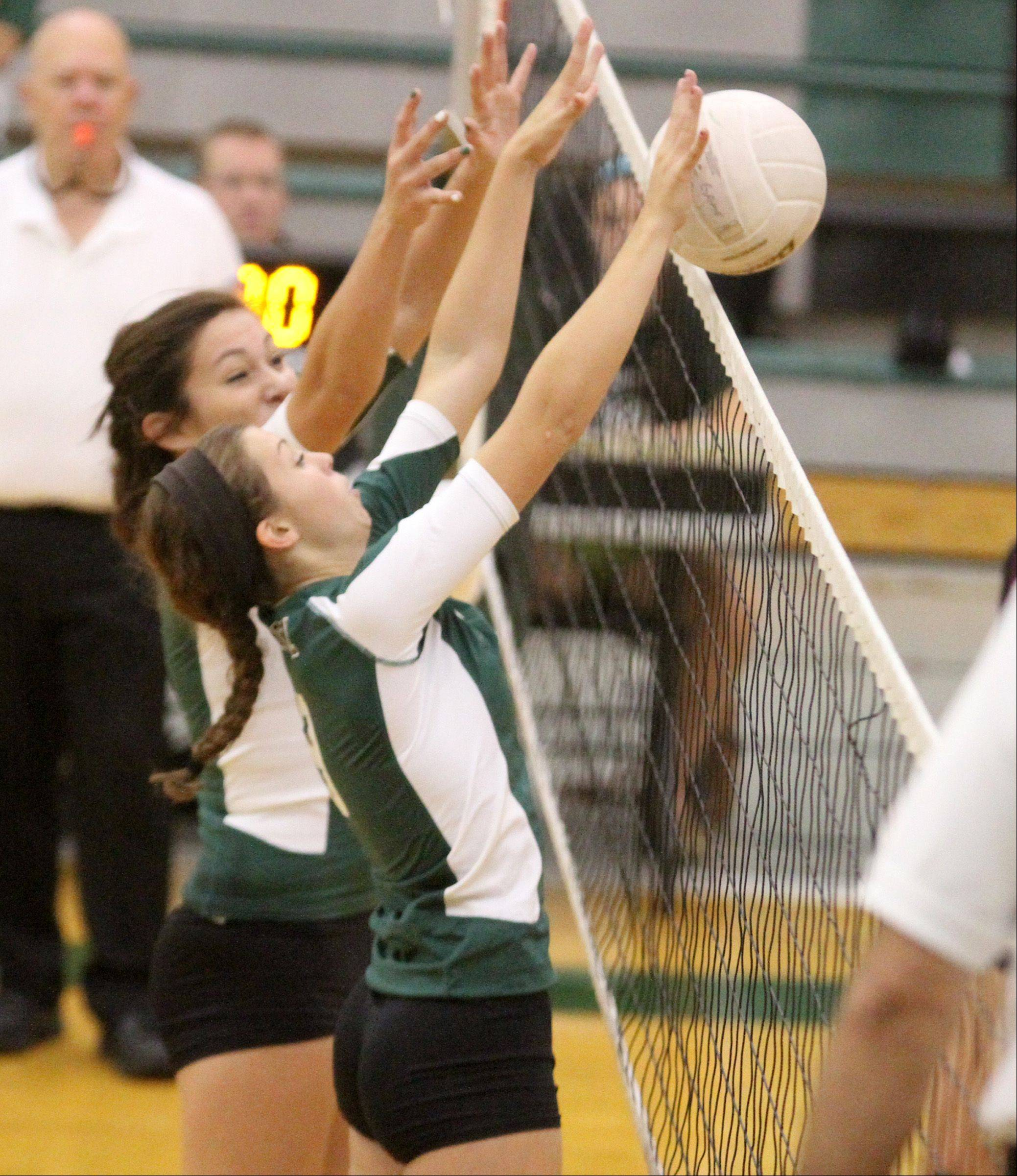 Grayslake Central's Alyssa Armada, foreground, and Caitlin Barry block the hit by Richmond-Burton at Grayslake Central on Saturday.
