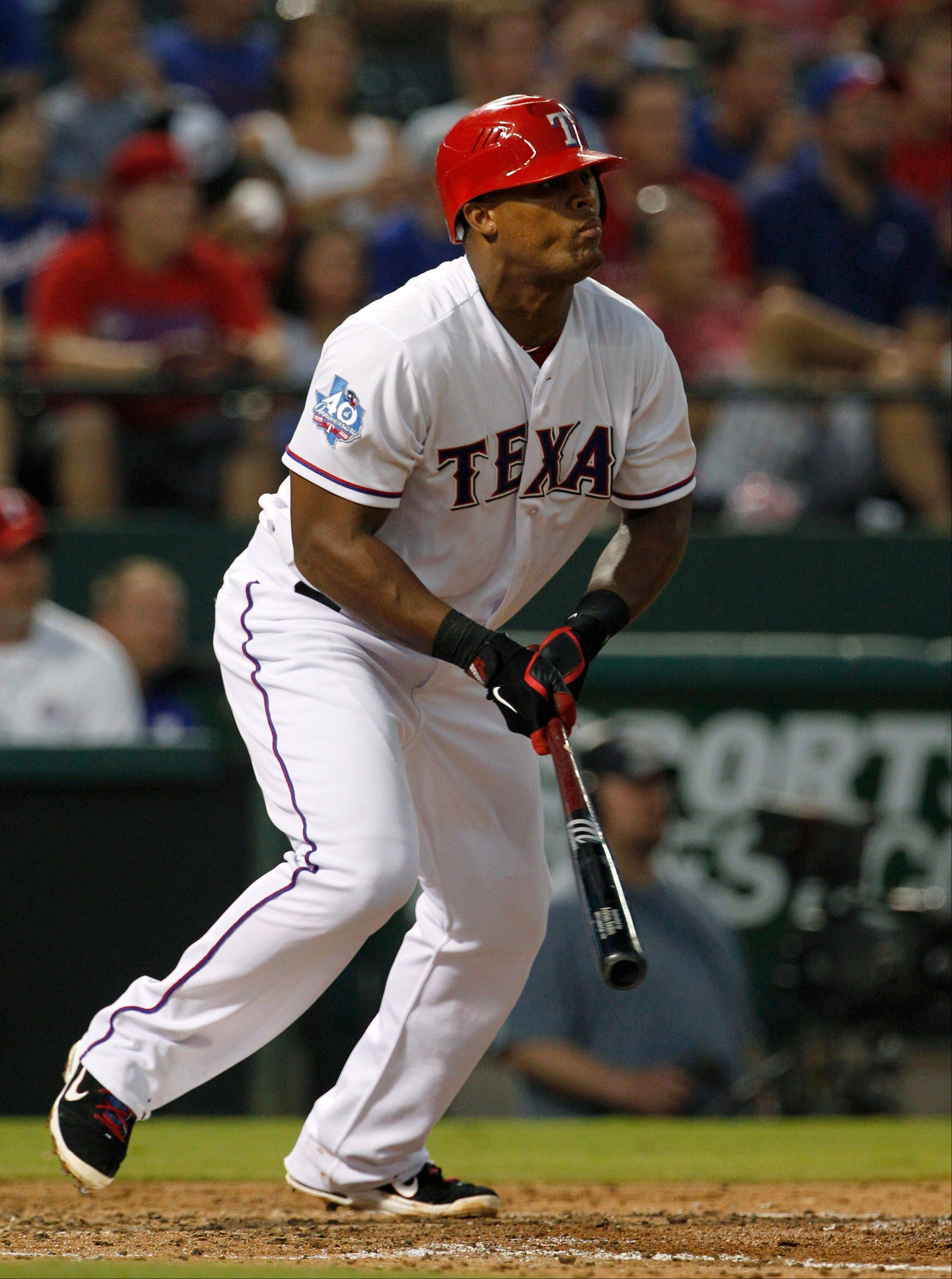 The Rangers' Adrian Beltre follows through on a double to right in the third inning Monday against the Tampa Bay Rays in Arlington, Texas.