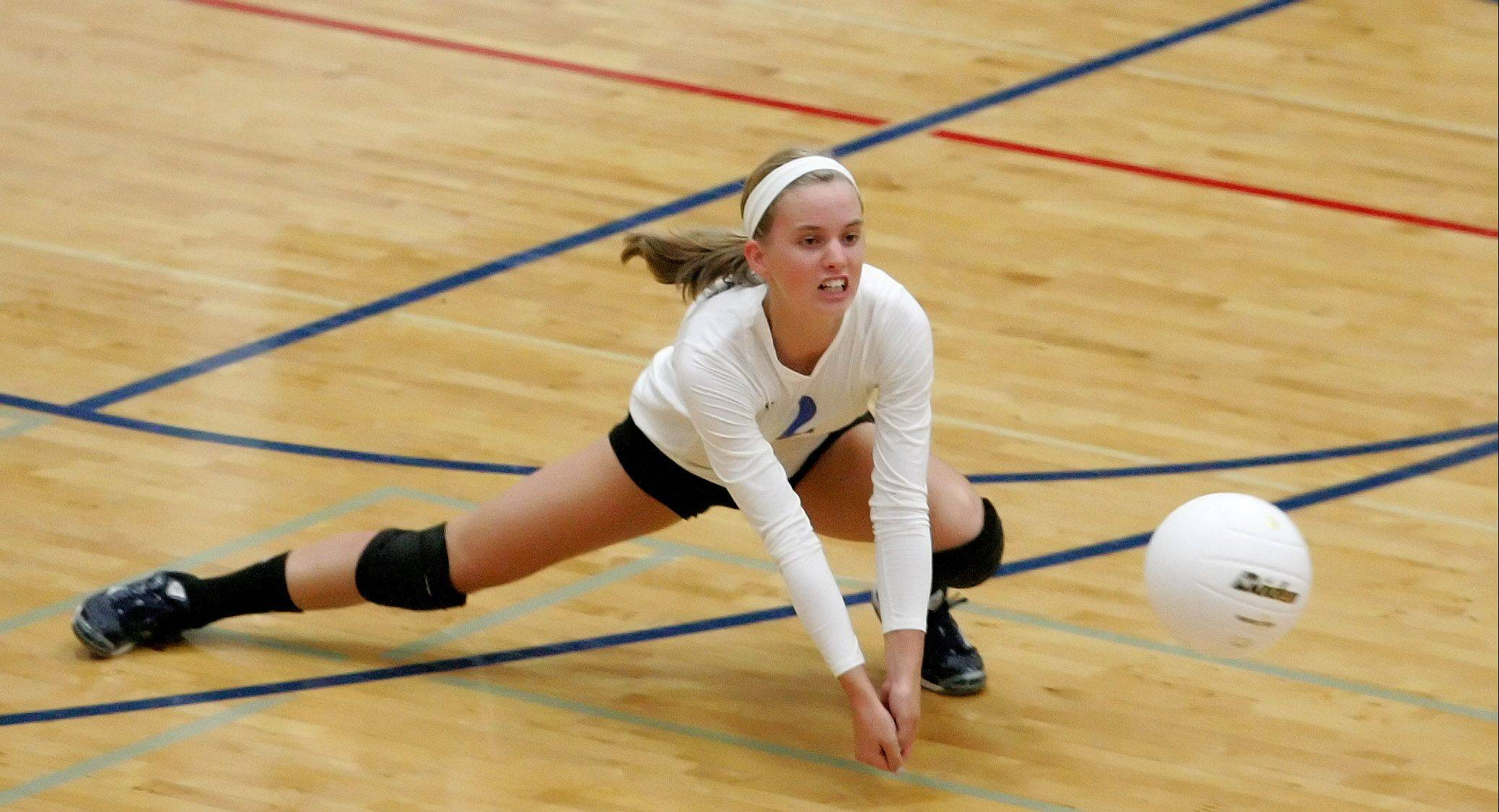 Kelly Dalheim of Geneva dives for a ball in action against West Aurora during girls volleyball in Aurora on Monday.