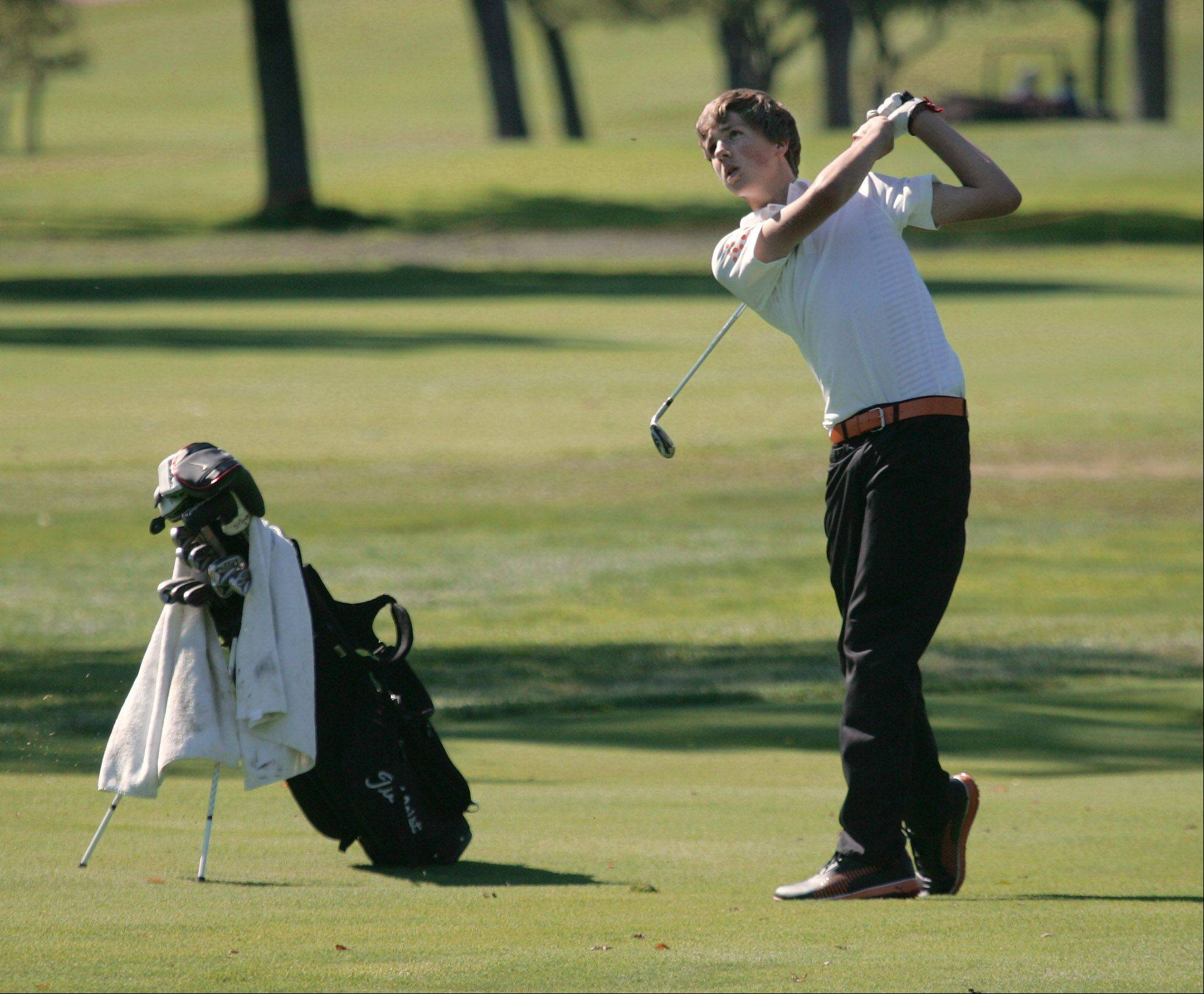 St. Charles East's Max Kelly chips onto the green at No. 1 during invitational play at Biltmore Country Club on Monday.