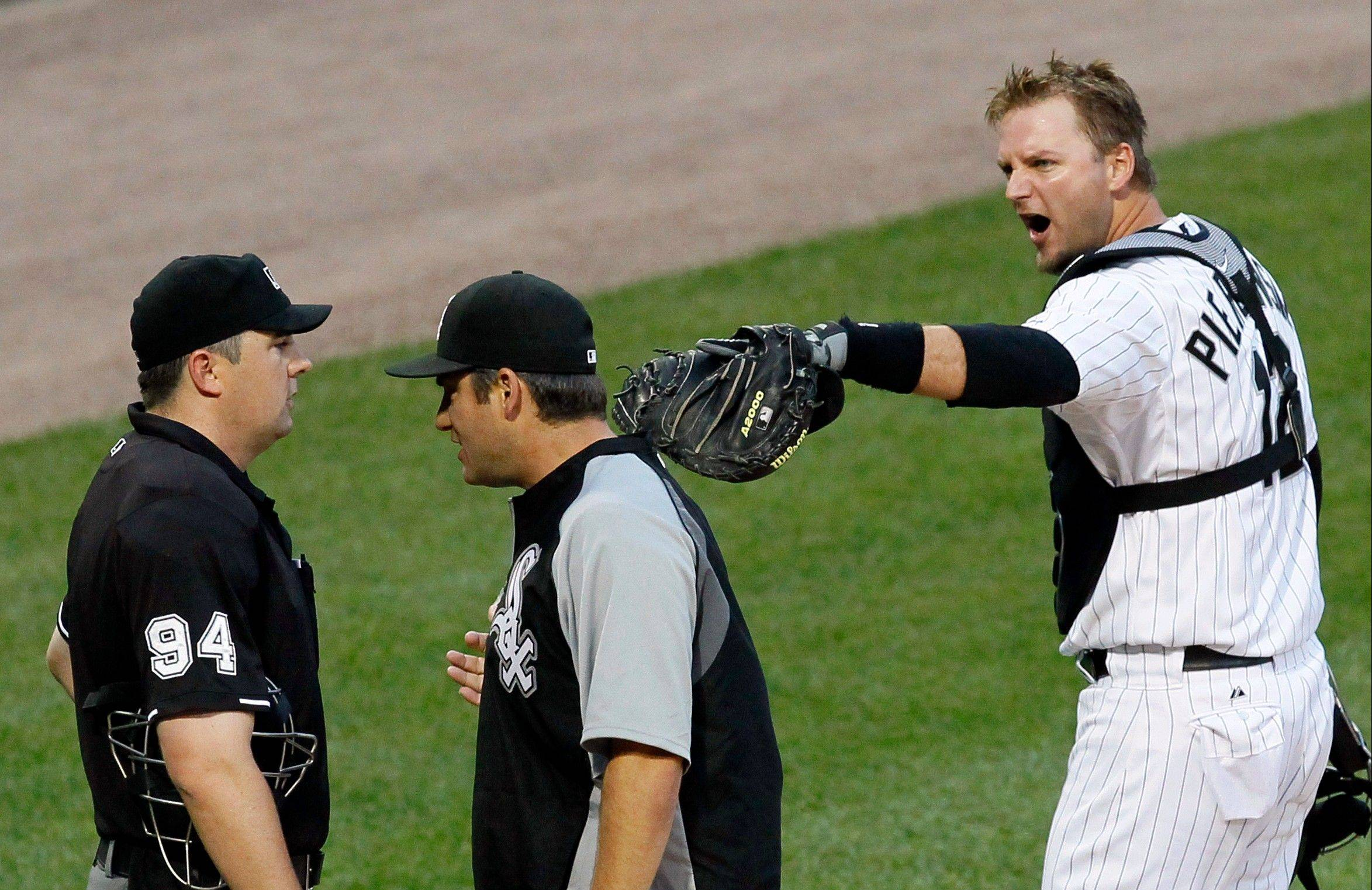 White Sox catcher A.J. Pierzynski, an extremely popular figure on the South Side who brings his unique brand of skills and pugnacious attitude to every game, will be a free agent after this season. In this photo taken Saturday, Pierzynski has just been ejected from the game against the Mariners by plate umpire Lance Barrett, while White Sox manager Robin Ventura carries on the argument.