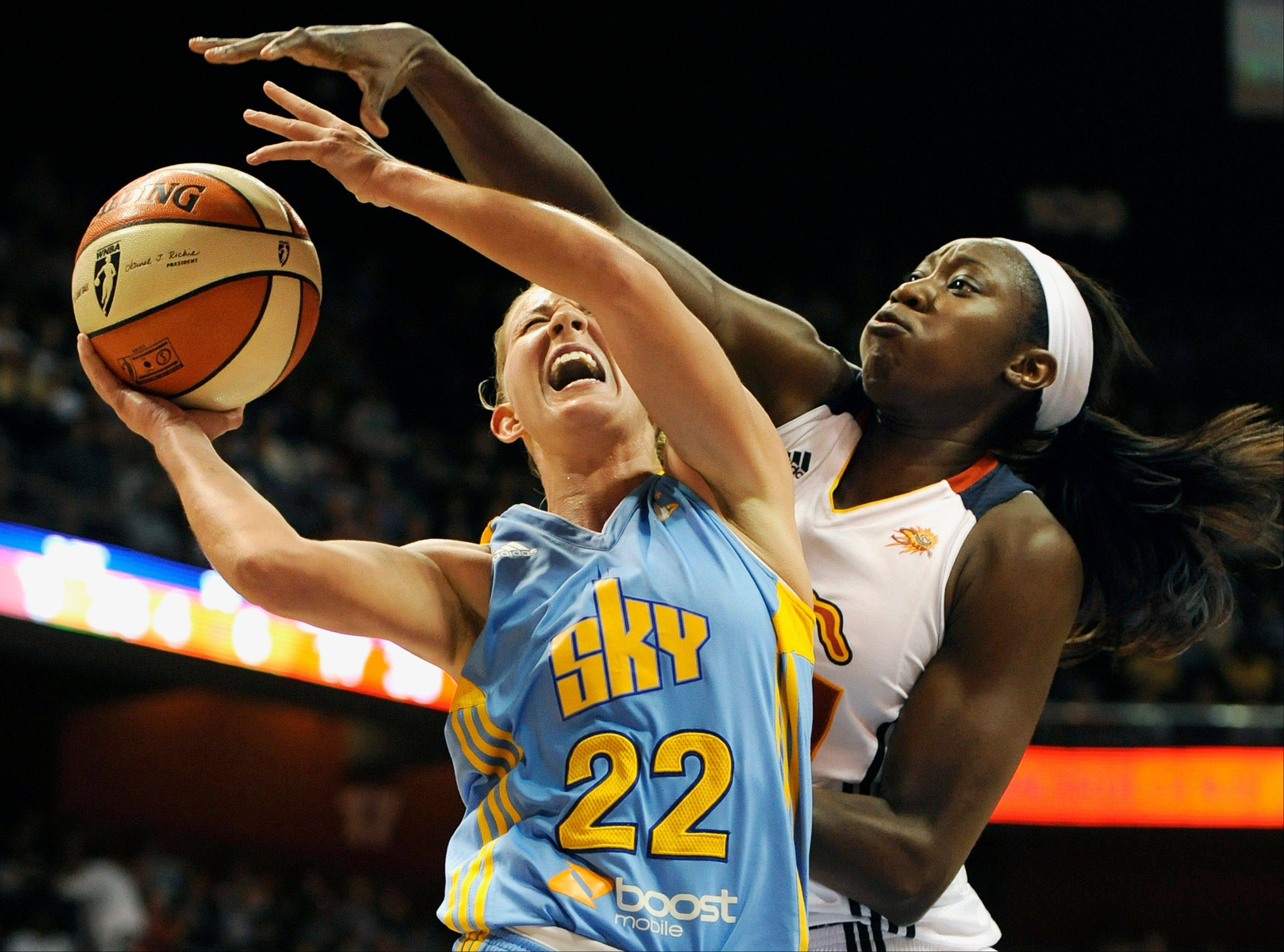 Courtney Vandersloot (22) is fouled by Connecticut Sun's Tina Charles in Sunday's 82-70 road victory. Vandersloot was among five Sky players to score 10 or more points.