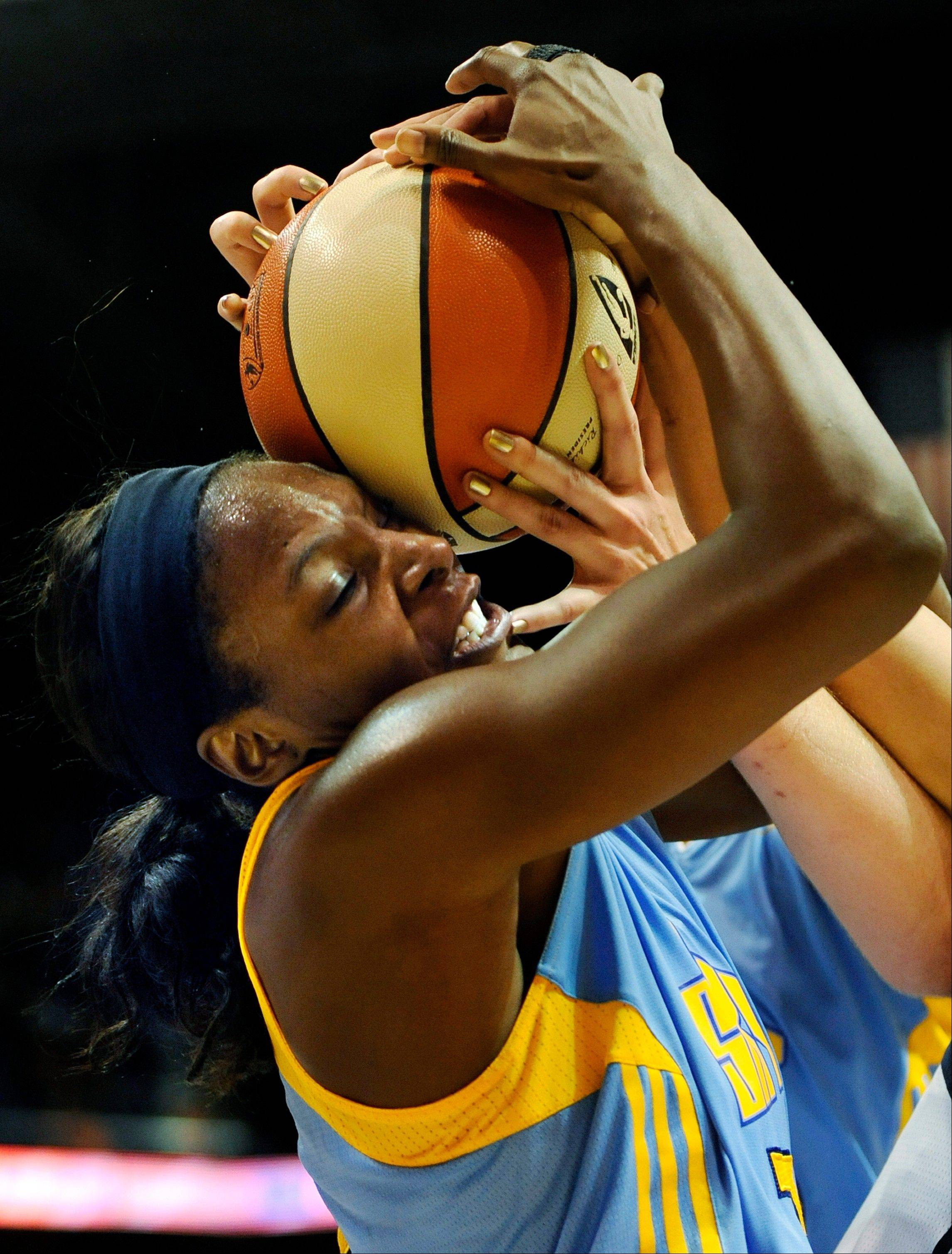 Shay Murphy of the Sky snags an offensive rebound Sunday against the Connecticut Sun. Murphy's all-around game helped the Sky snap a nine-game losing streak and beat the team with the best record in the Eastern Conference.