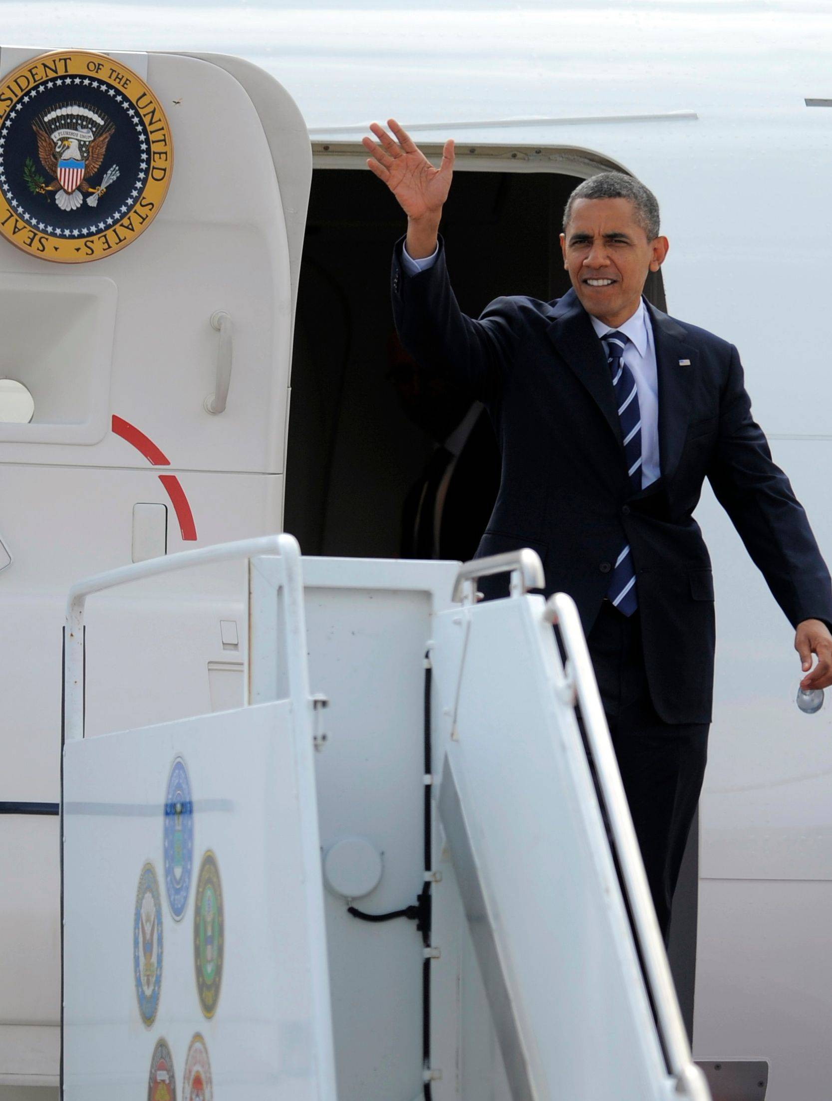 President Barack Obama waves arrives in Fort Collins, Colo., Tuesday to campaign after hours earlier assuring the nation his administration was capable of handling the problems Hurricane Isaac may cause.