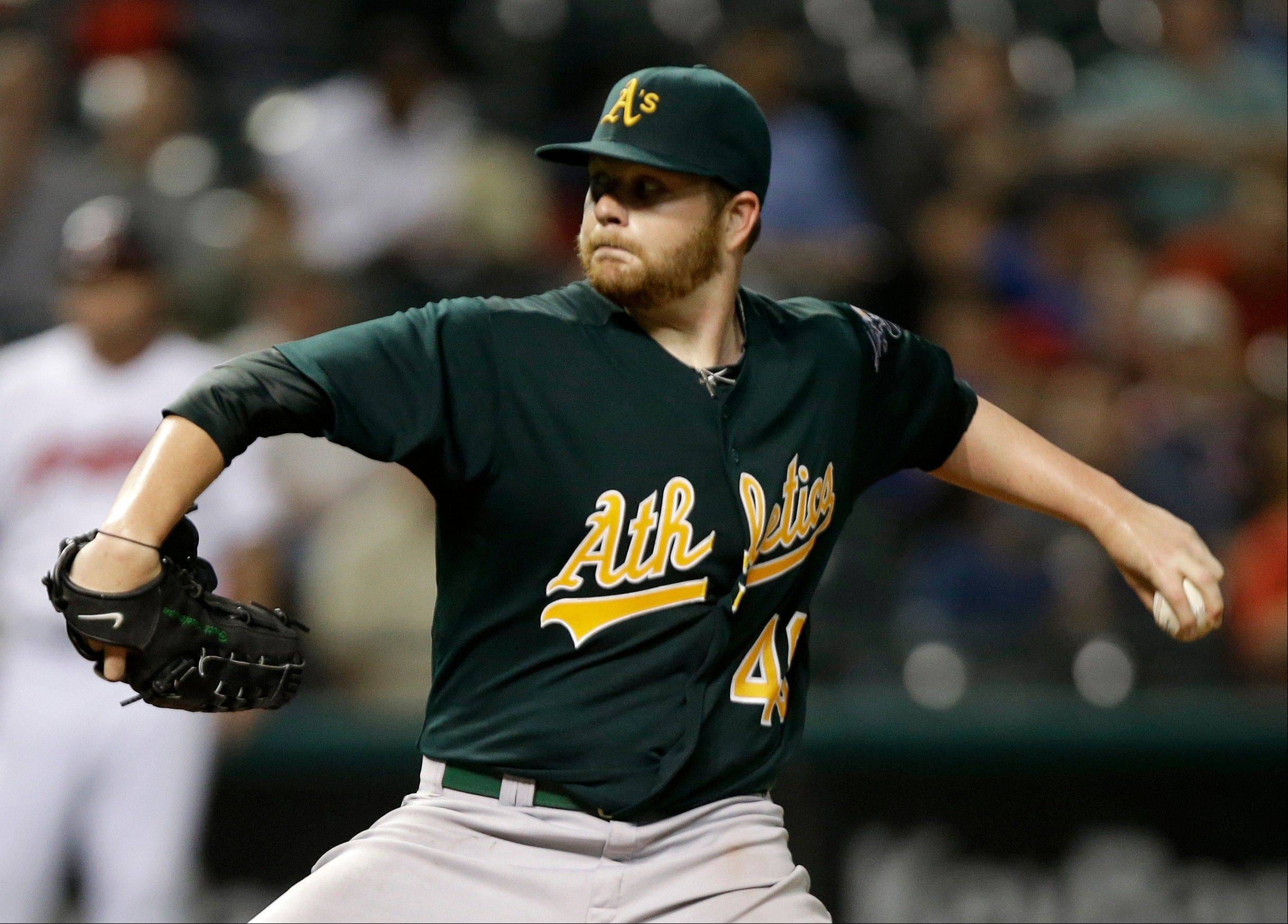Oakland starting pitcher Brett Anderson delivers against the Indians in the seventh inning Monday in Cleveland.