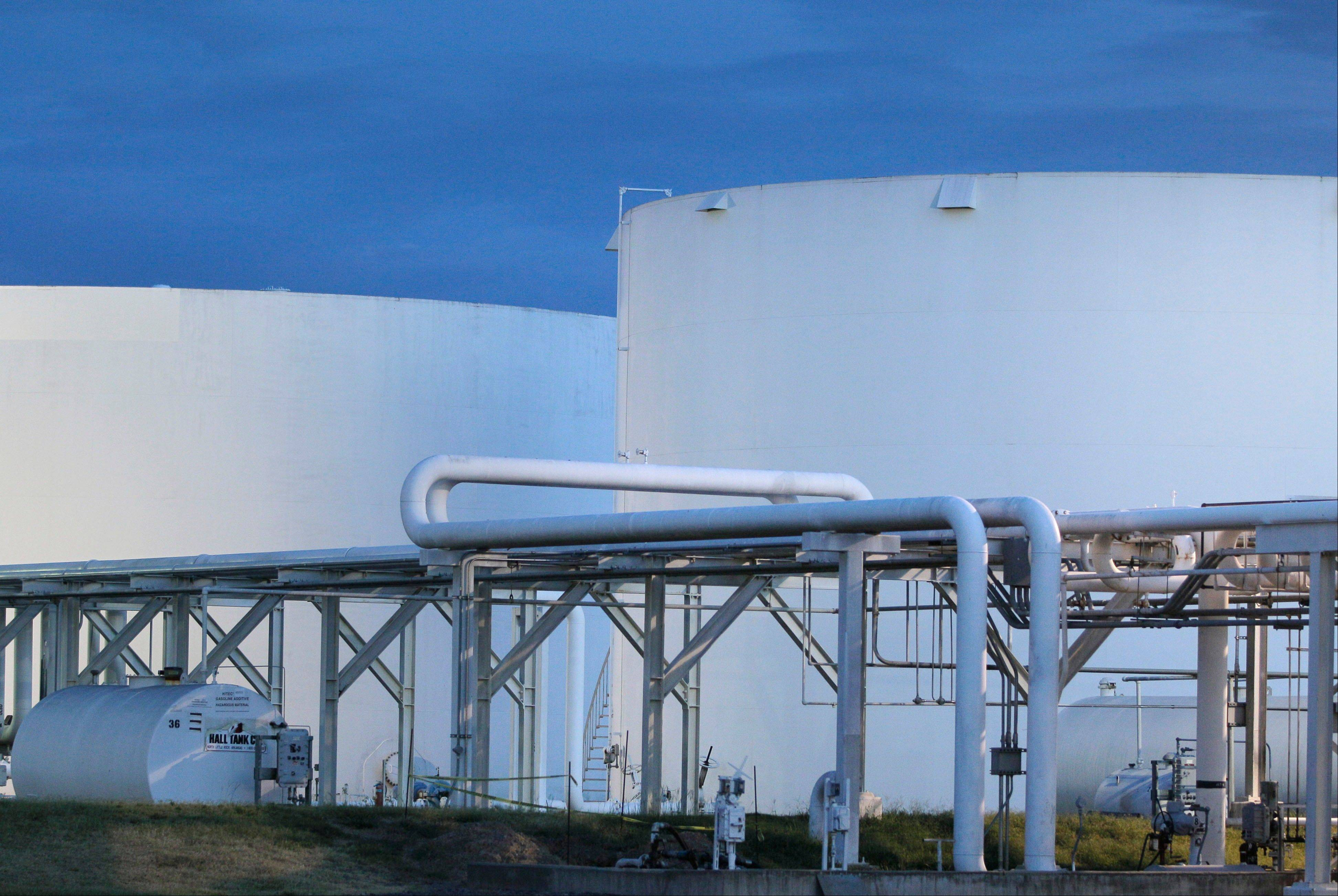 Early morning sunlight illuminates fuel storage tanks at a North Little Rock, Ark., petroleum distributorship.