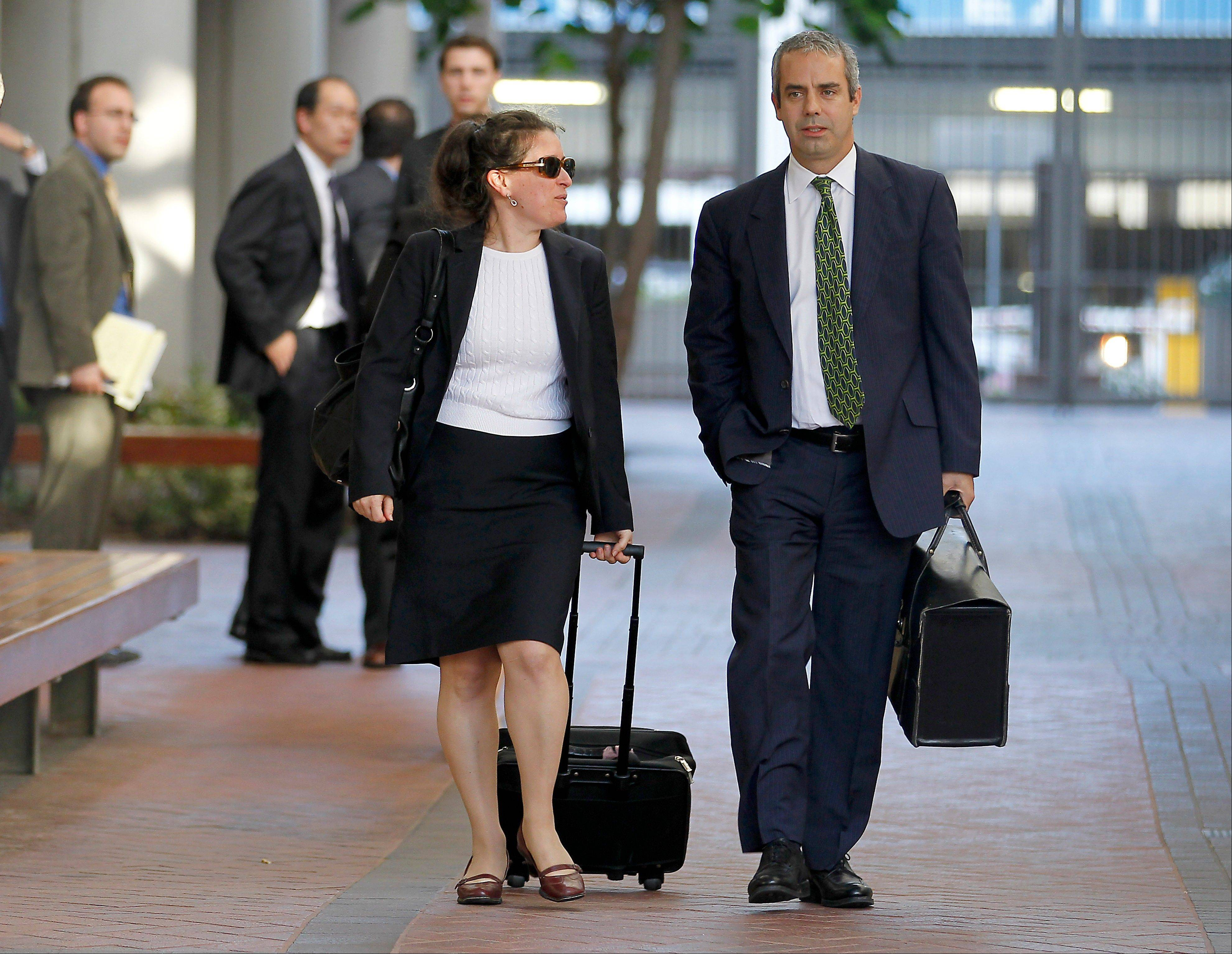 Kevin Johnson, right, and Victoria Maroulis, left, attorneys for Samsung, leave the US Courthouse and Federal building after a jury reached a decision in the Apple Samsung trial.