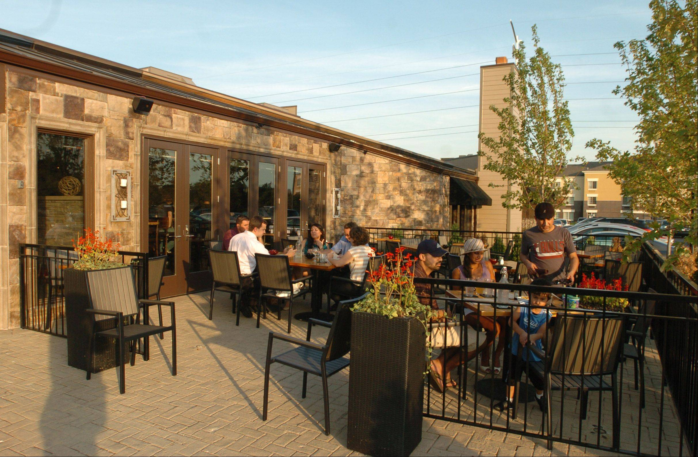 A patio provides outdoor seating at Lombard's Trademark Tavern.
