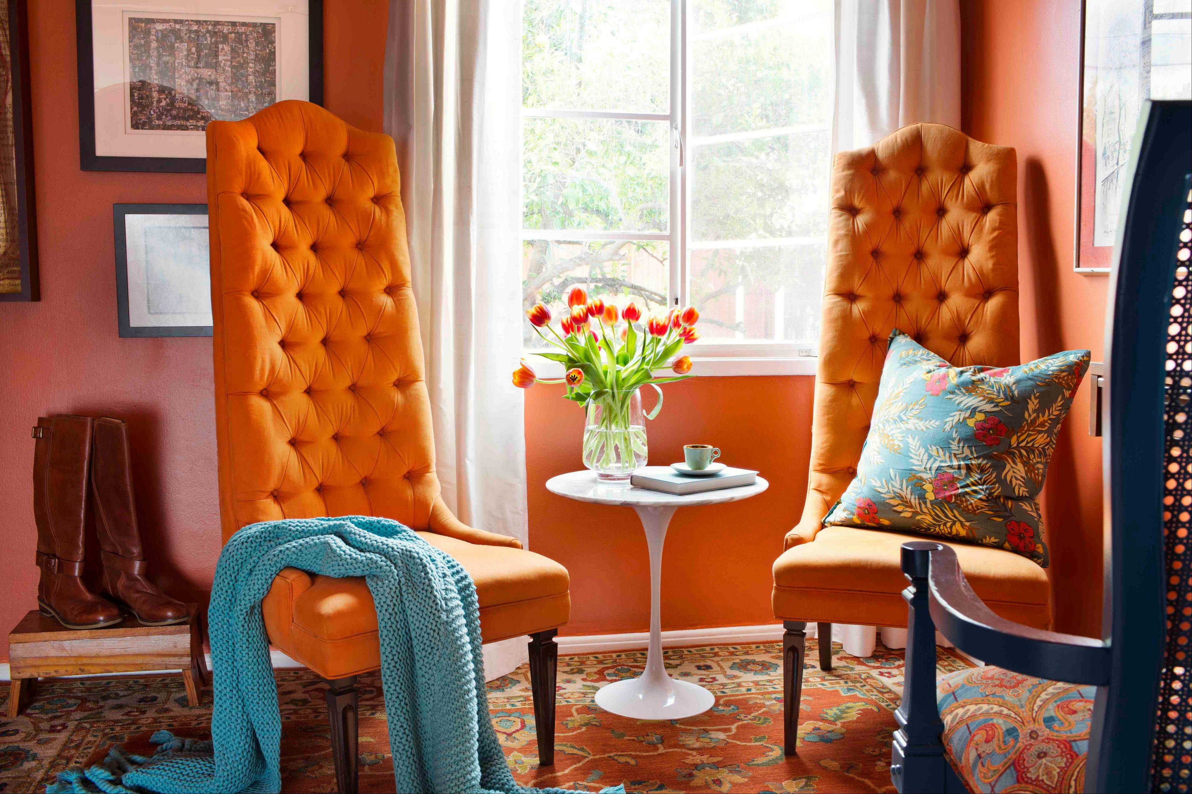 The lush orange trees of California serve as inspiration in a client's den for designer Brian Patrick Flynn, where he layered several shades of orange throughout the space to bring vacation memories home.