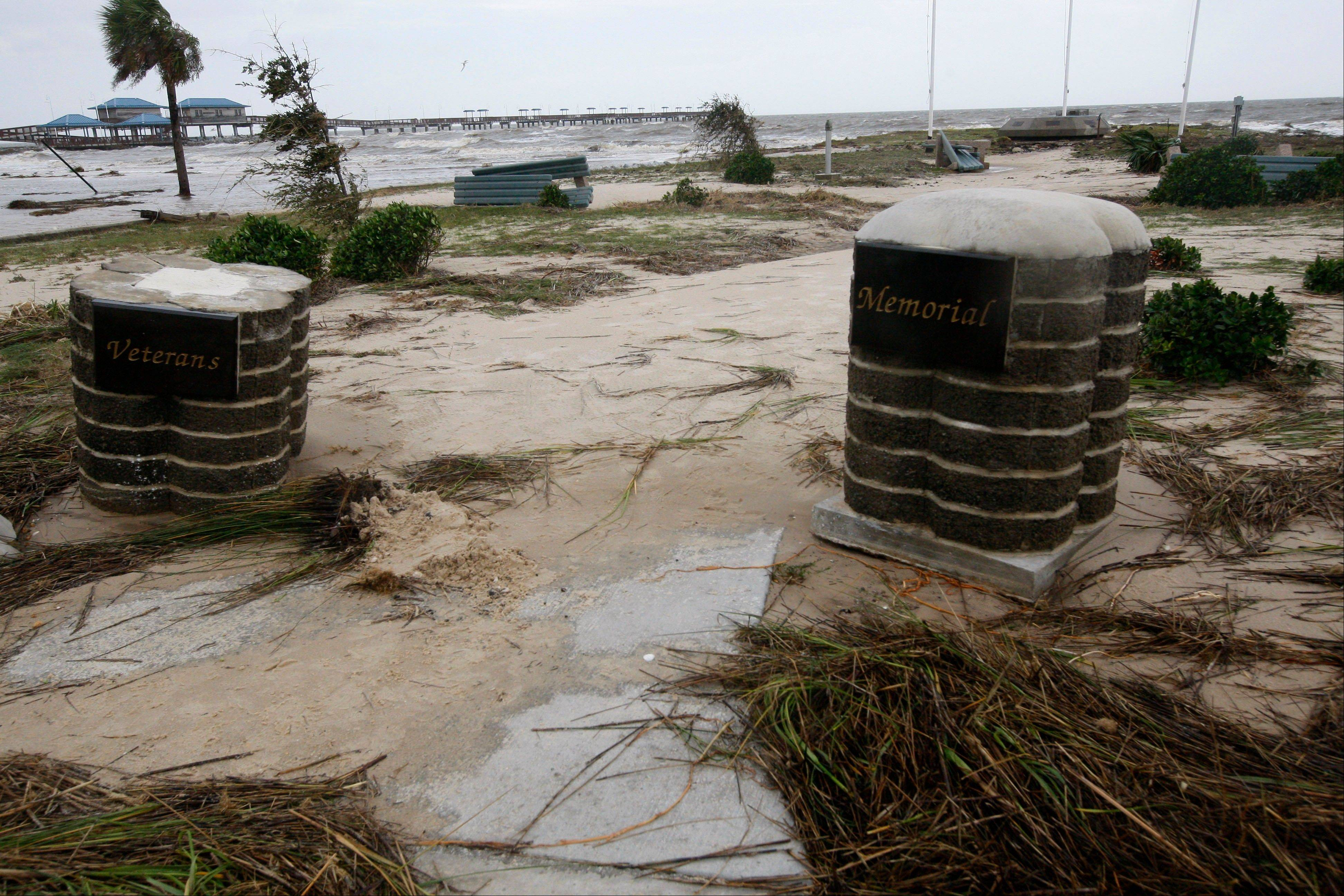 Hurricane Isaac heavily damaged the Veterans Memorial along the seawall in Waveland, Miss., Thursday, Aug. 30, 2012.