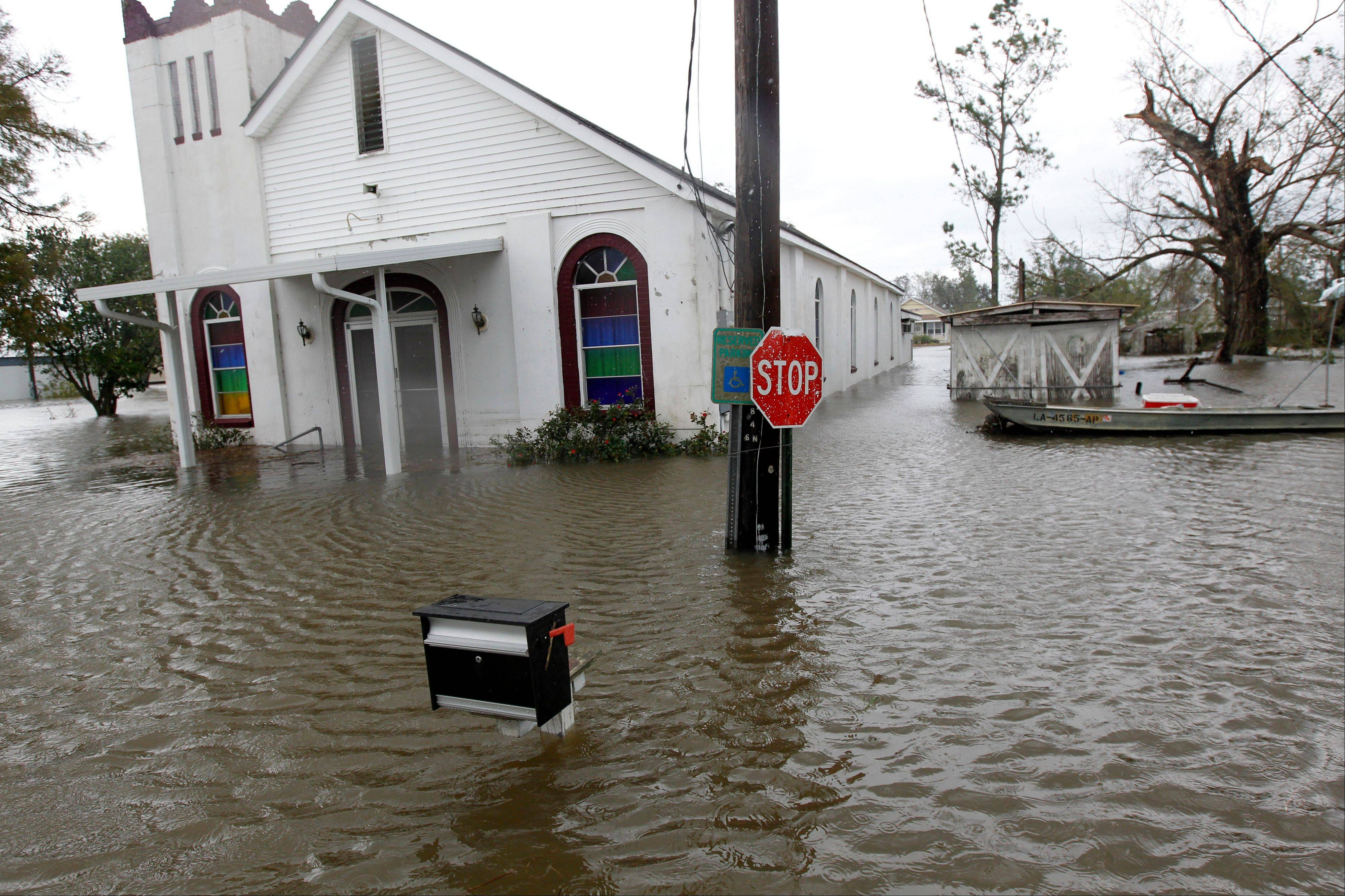 The St. Paul Missionary Baptist Church is seen flooded after Isaac passed through the region, in Plaquemines Parish, La., Thursday, Aug. 30, 2012.