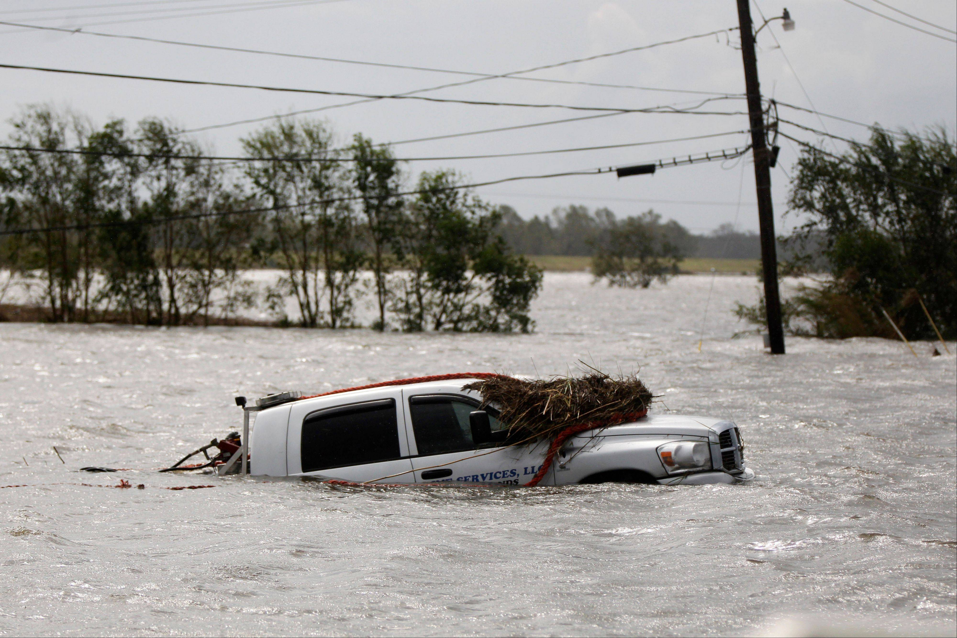 A car sits submerged after Isaac passed through the region, in Plaquemines Parish, La., Thursday, Aug. 30, 2012.