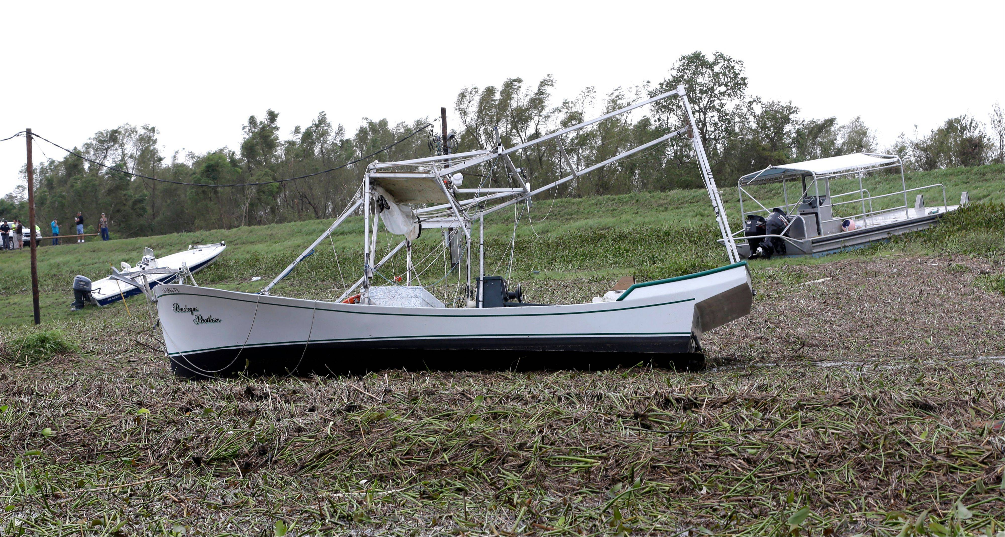 Boats sit on dry land in the aftermath of Hurricane Isaac in Braithwaite, La.,Thursday, Aug. 30, 2012.