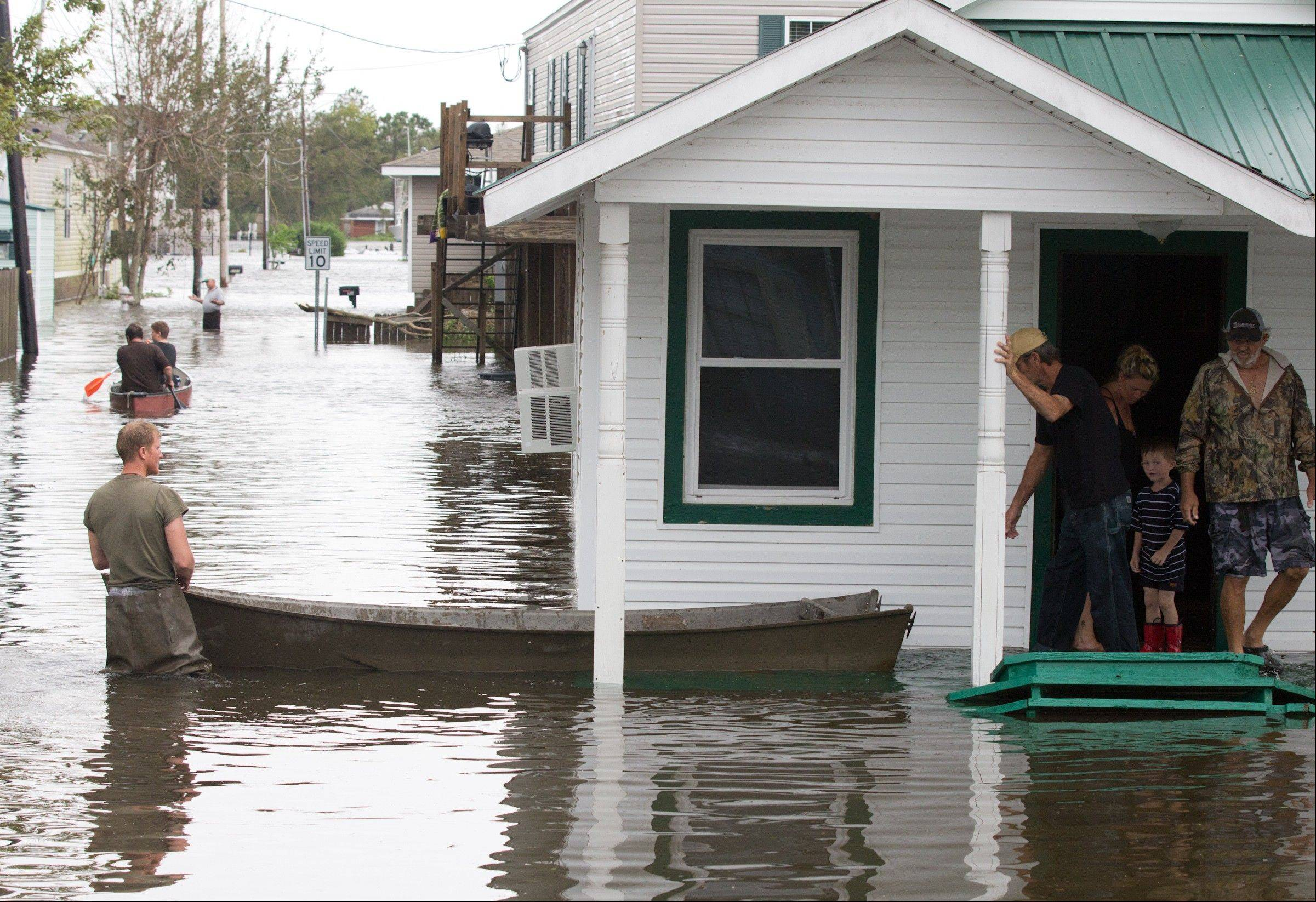 Flooding in Lafitte, La., causes residents to travel by boat on Thursday, Aug. 30, 2012.