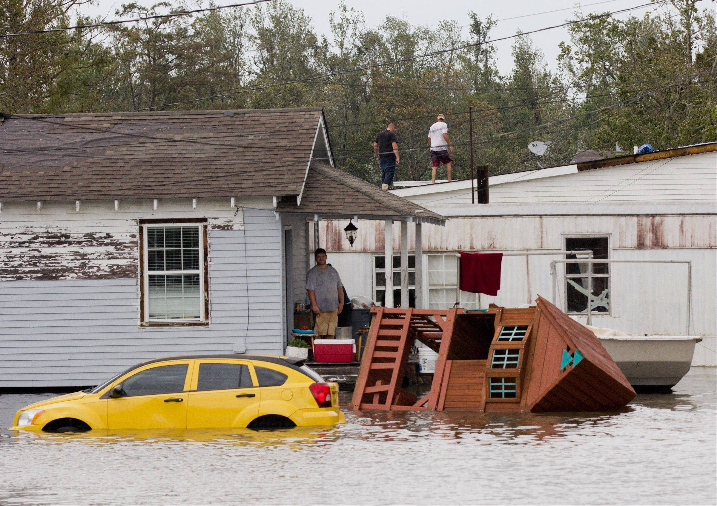 Residents survey flood damage in Lafitte, La., on Thursday,, Aug. 30, 2012.