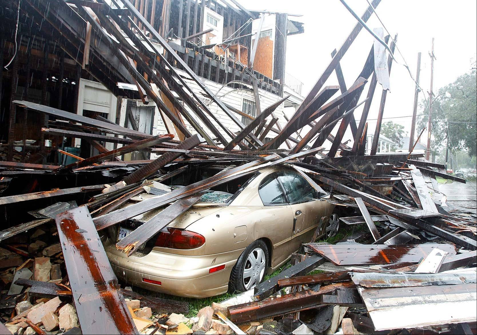 A house at the corner of N. Miro and Columbus Streets in New Orleans collapsed during the height of the Hurricane Isaac.