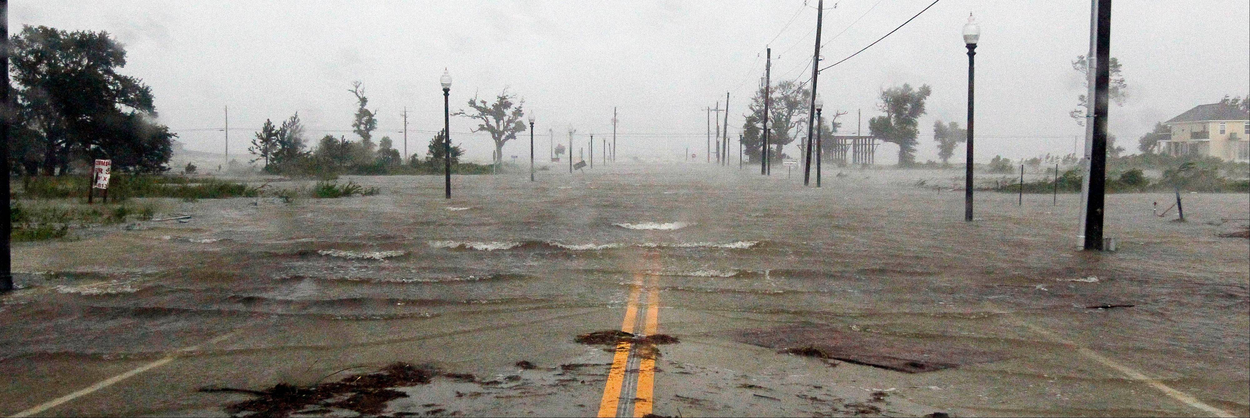 Isaac's winds and storm surge flood parts of Waveland, Miss., Wednesday, Aug. 29, 2012.