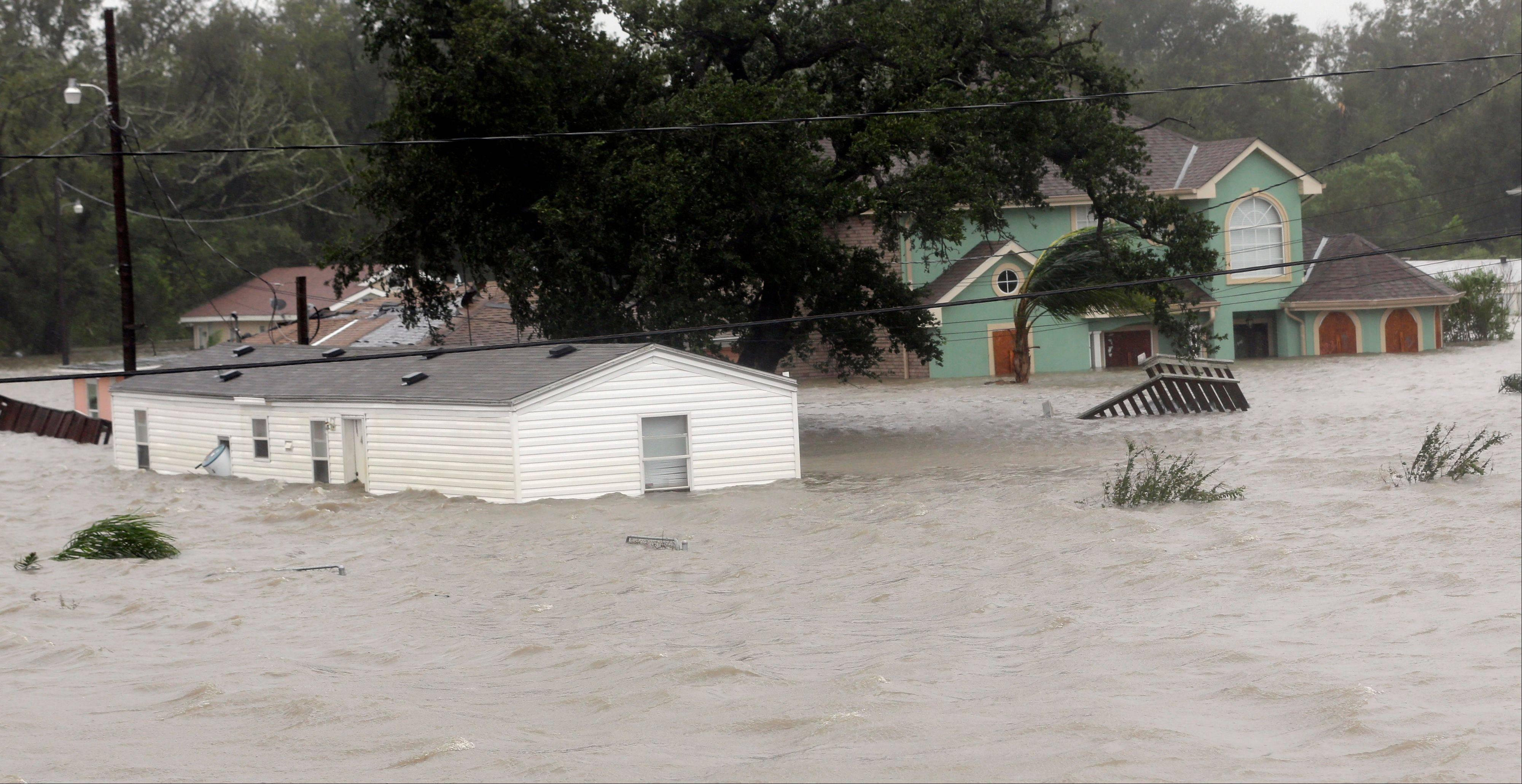 Homes are flooded as Hurricane Isaac hits Wednesday, Aug. 29, 2012, in Braithwaite, La.