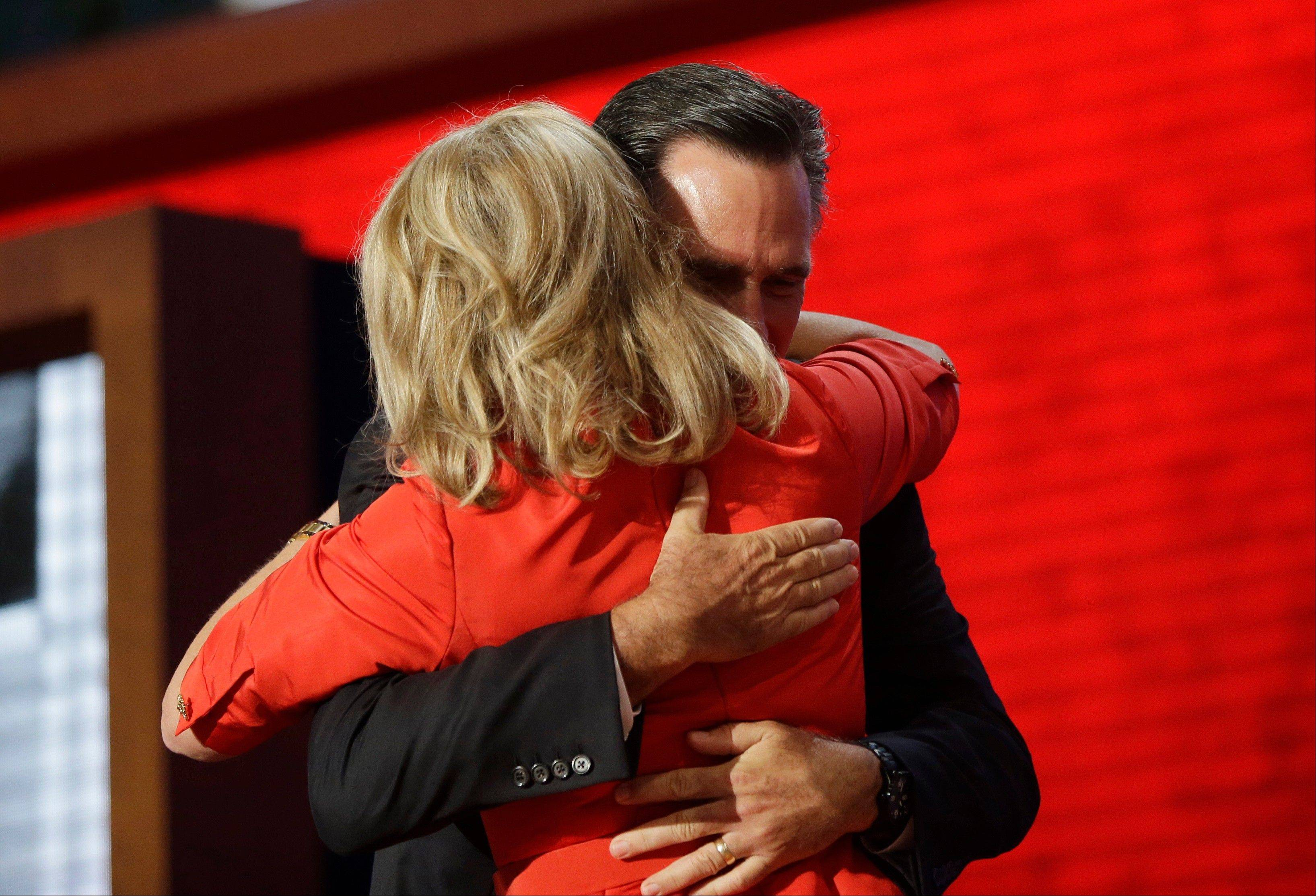 Republican presidential nominee Mitt Romney hugs his wife Ann Romney on stage at the Republican National Convention in Tampa, Fla. on Tuesday, Aug. 28, 2012.