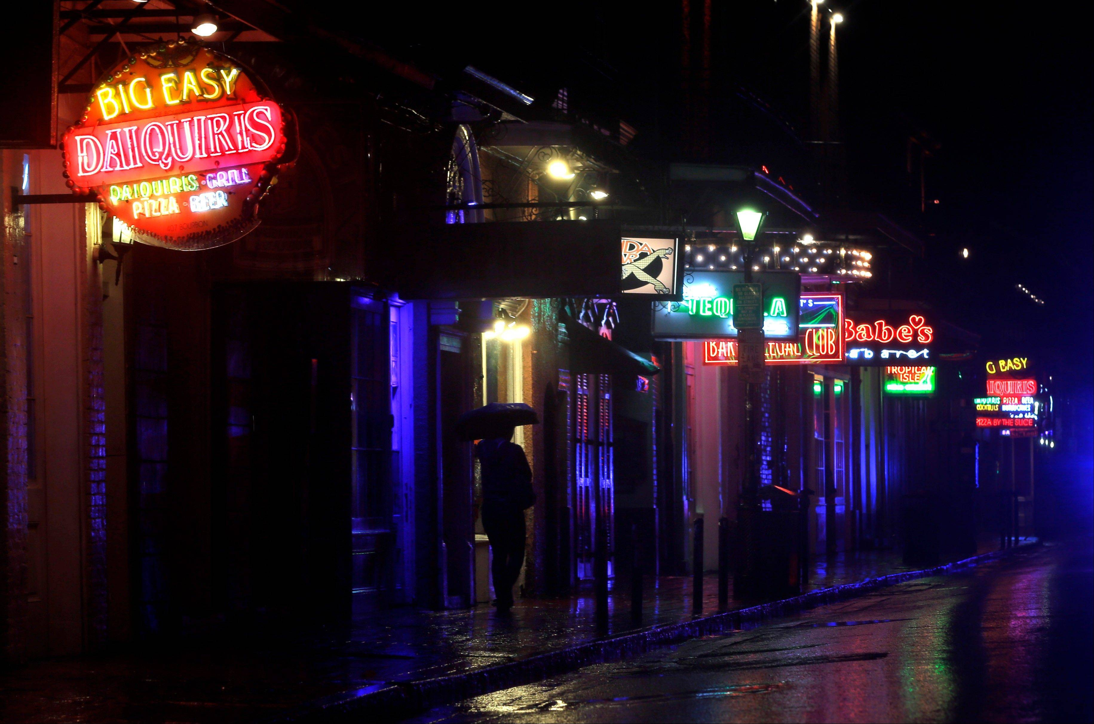 A deserted Bourbon Street in the French Quarter is shown as Hurricane Isaac makes landfall Tuesday, Aug. 28, 2012, in New Orleans.