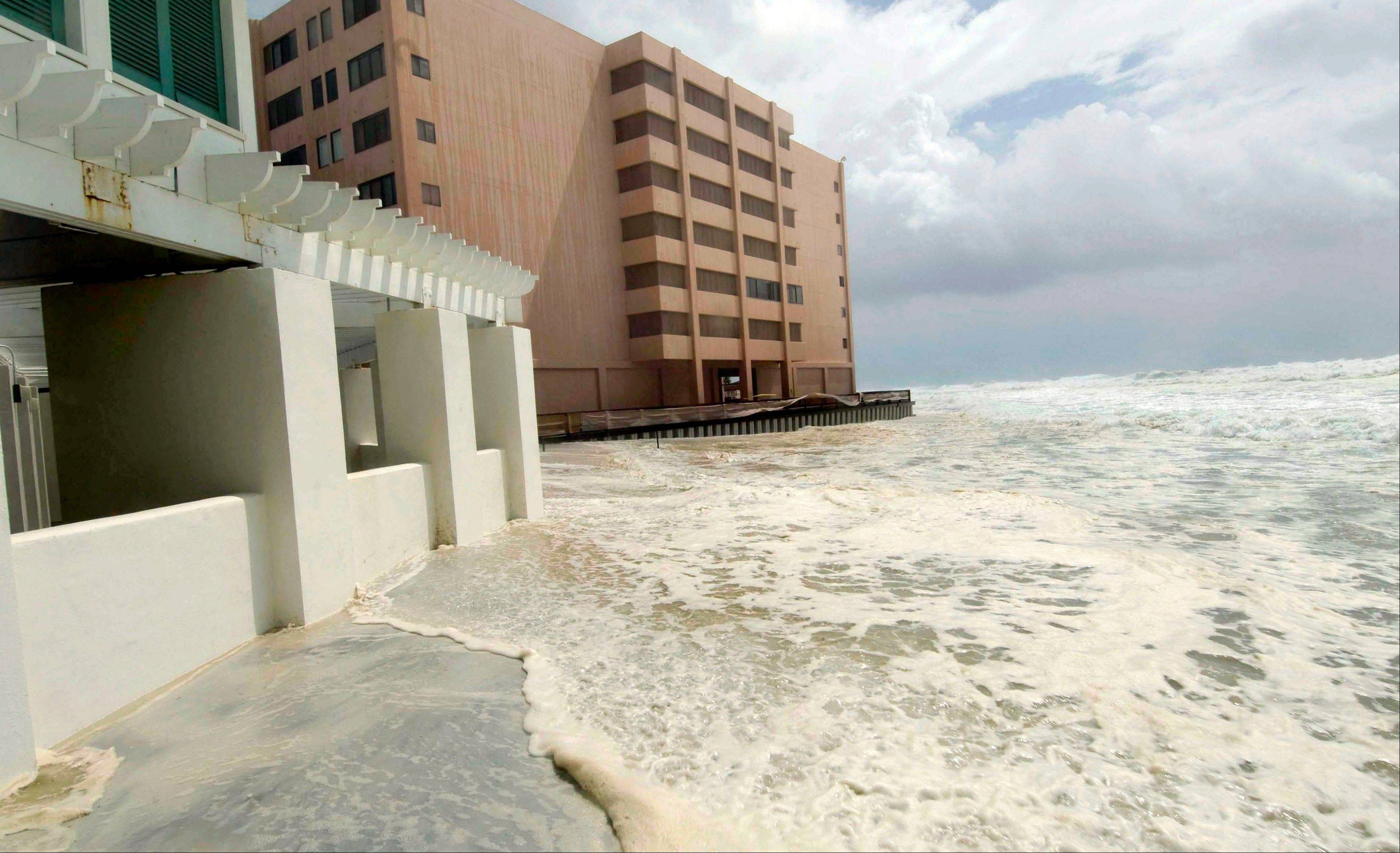 Waves from Isaac crash against the Jetty East condominium in Destin, Fla., Tuesday, Aug. 28, 2012 as the storm makes its way toward expected landfall in Louisiana.