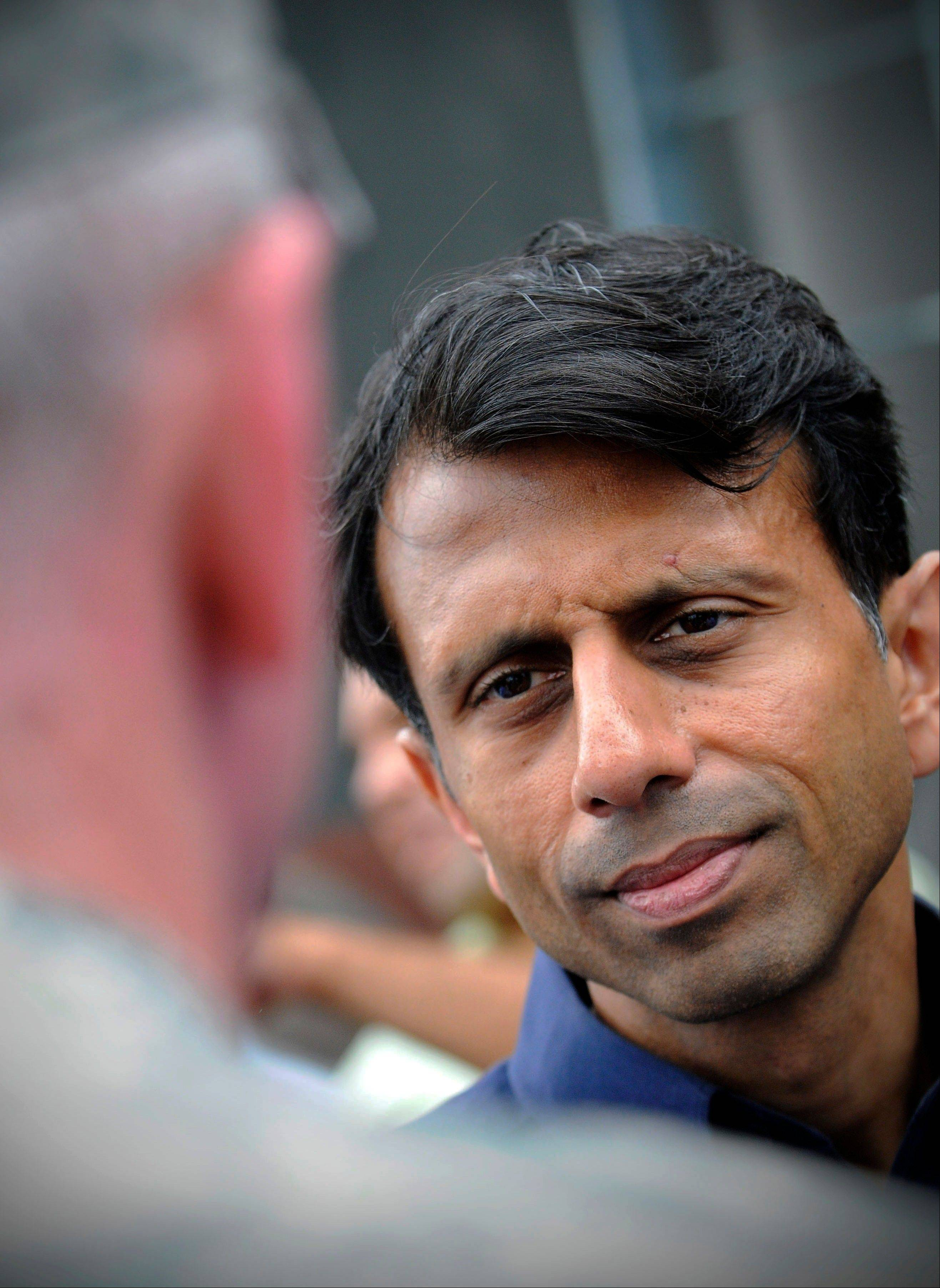 Louisiana Gov. Bobby Jindal listens to Army Corps of Engineers Col. Ed Fleming while touring the new levee wall and pumps at the 17th Street Canal in New Orleans, built after Hurricane Katrina, as Hurricane Isaac approaches, Tuesday, Aug. 28, 2012.