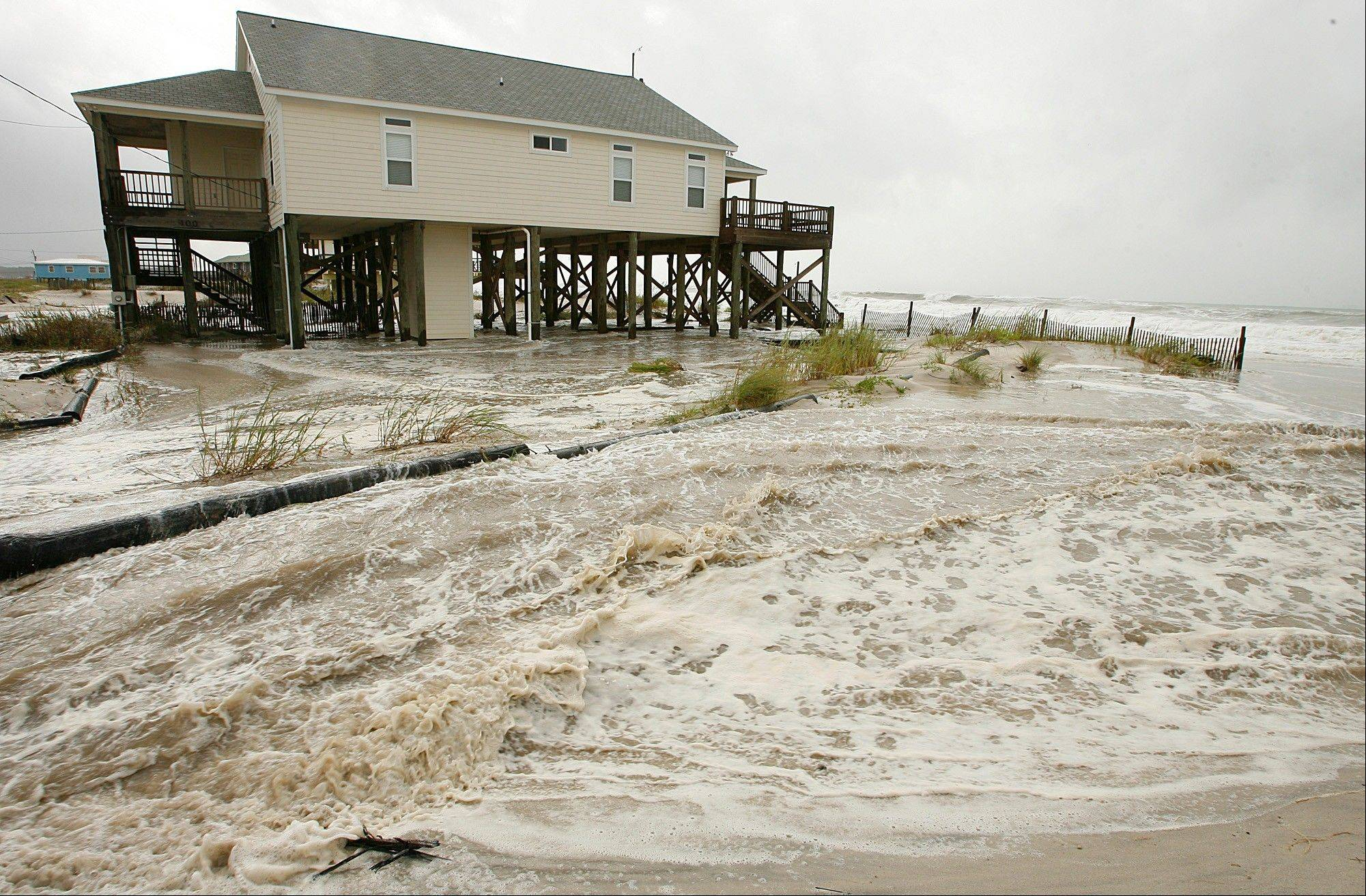 Waves crash Tuesday, Aug. 28, 2012, in Dauphin Island, Ala., as Isaac approaches the Gulf Coast.