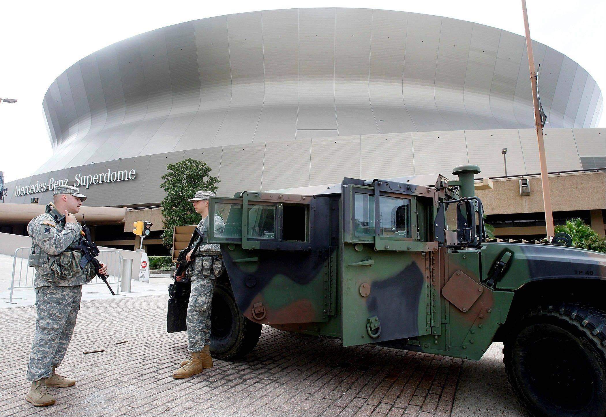 National Guardsmen Sgt. Matthew Limbert, left, and Cadet Clovis Vaughn of the 141st Field Artillery stationed at Jackson Barracks in New Orleans, guard the Superdome as Isaac approaches New Orleans on Tuesday, Aug. 28, 2012.