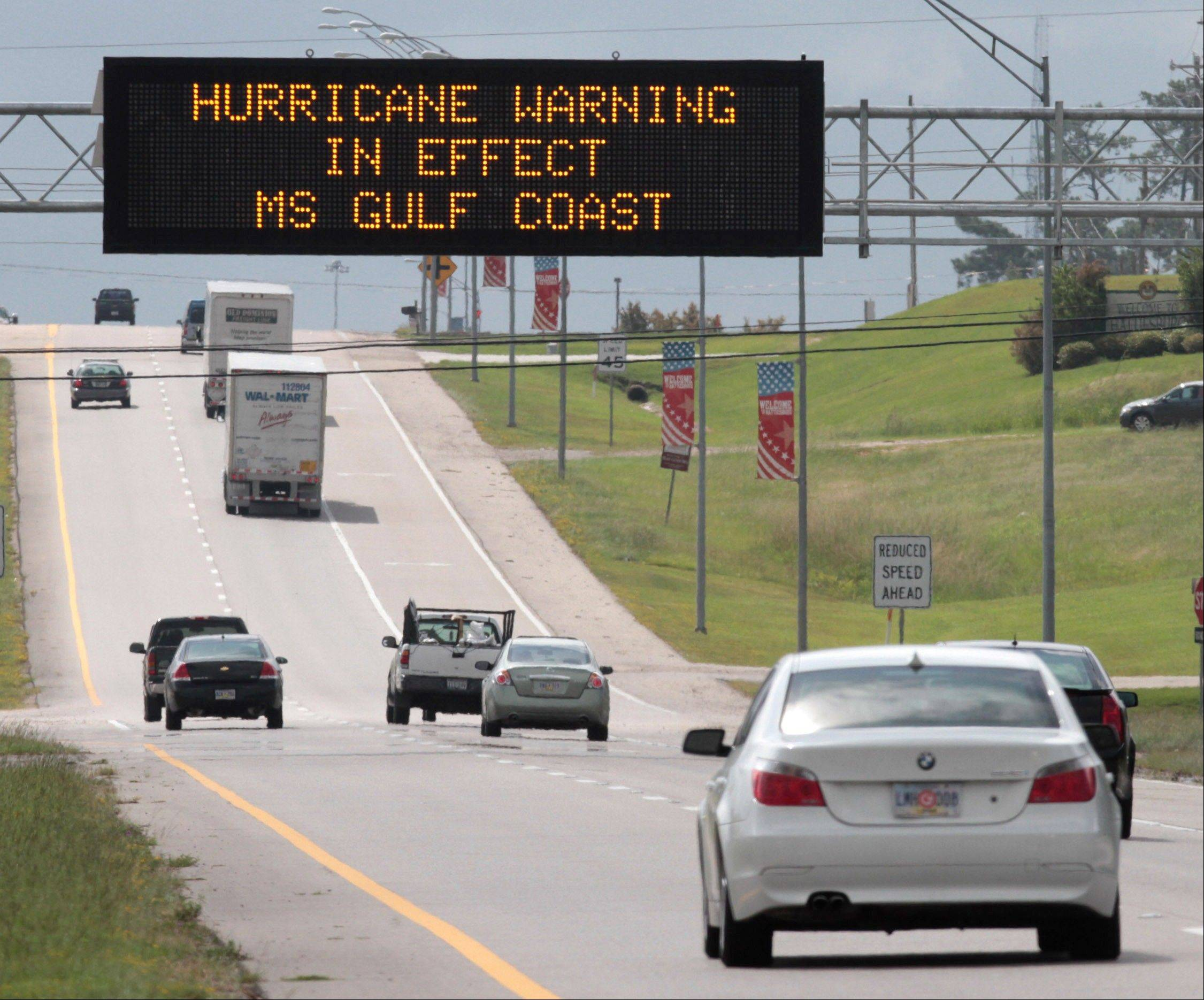 A Mississippi Department of Transportation sign in Hattiesburg, Miss., warns southbound motorists on U.S. 49 of weather conditions in South Mississippi on Tuesday Aug. 28, 2012.